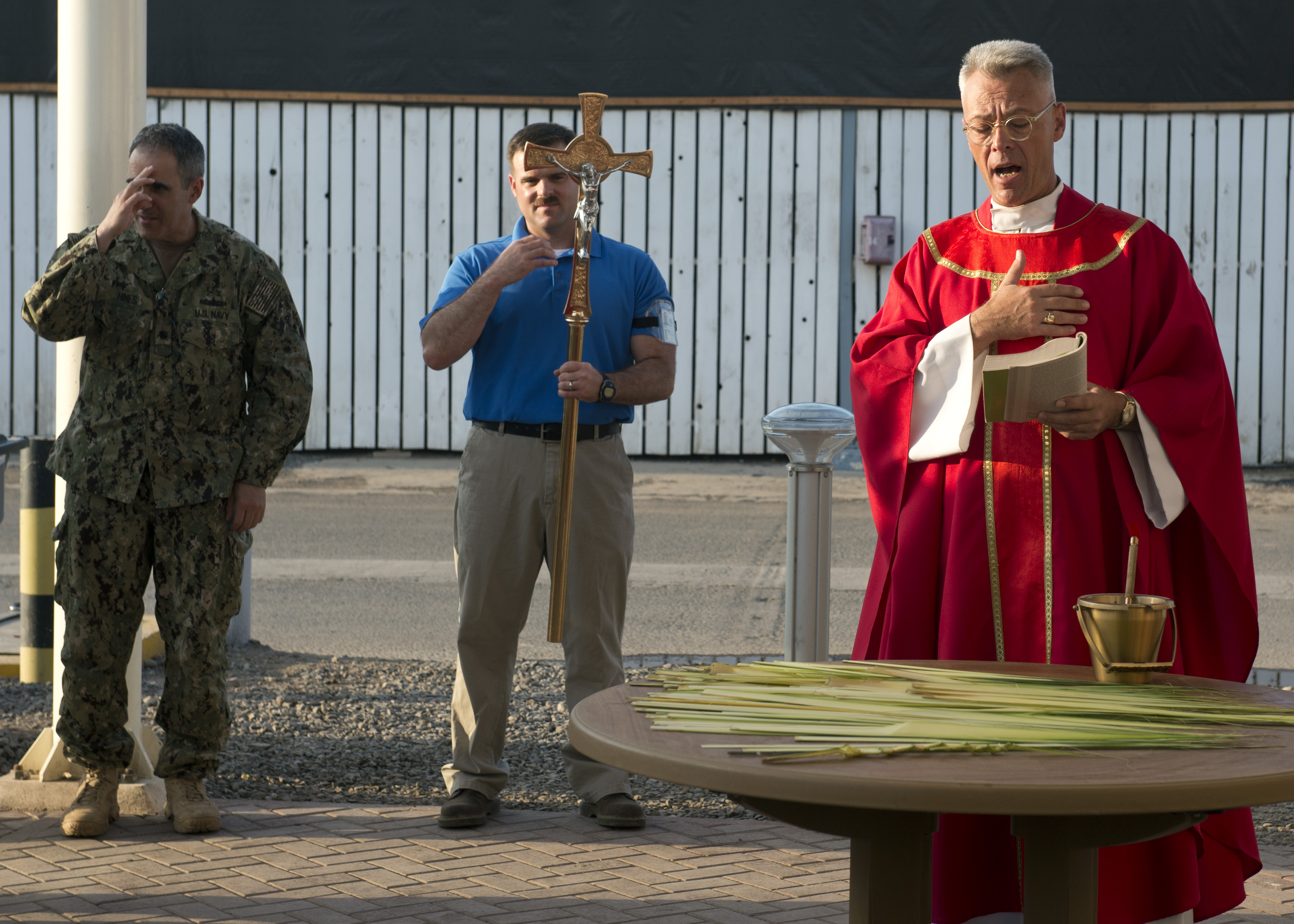 U.S. Navy Chaplain Capt. Sean O'Brien leads Catholic mass at Camp Lemonnier, Djibouti, Mar. 28, 2015. The Chaplain's priorities are to enhance Airmen's readiness by preparing them with spiritual resiliency, engaging them through ministry of presence and spiritual care and ensuring worship and religious education opportunities are available to all. (U.S. Air Force photo by Staff Sgt. Kevin Iinuma)