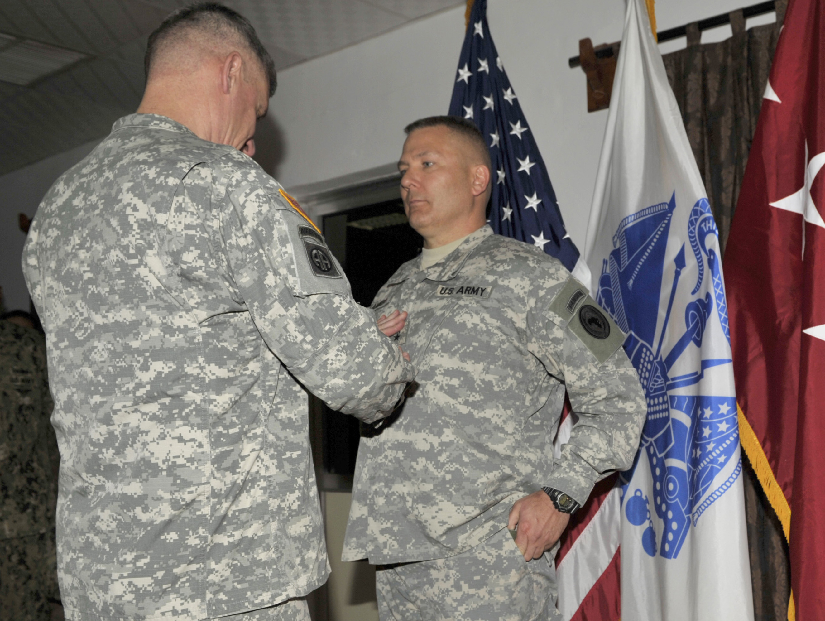 U.S. Army Gen. David Rodriguez, U.S. Africa Command commander, attaches rank insignia to U.S. Army Maj. Gen. Mark Stammer, CJTF-HOA incoming commanding general, during a frocking ceremony at Camp Lemonnier, Djibouti, April 13, 2015. Stammer was previously selected for promotion to major general and promoted prior to taking command of CJTF-HOA. (U.S. Air Force photo by Tech. Sgt. Ian Dean)