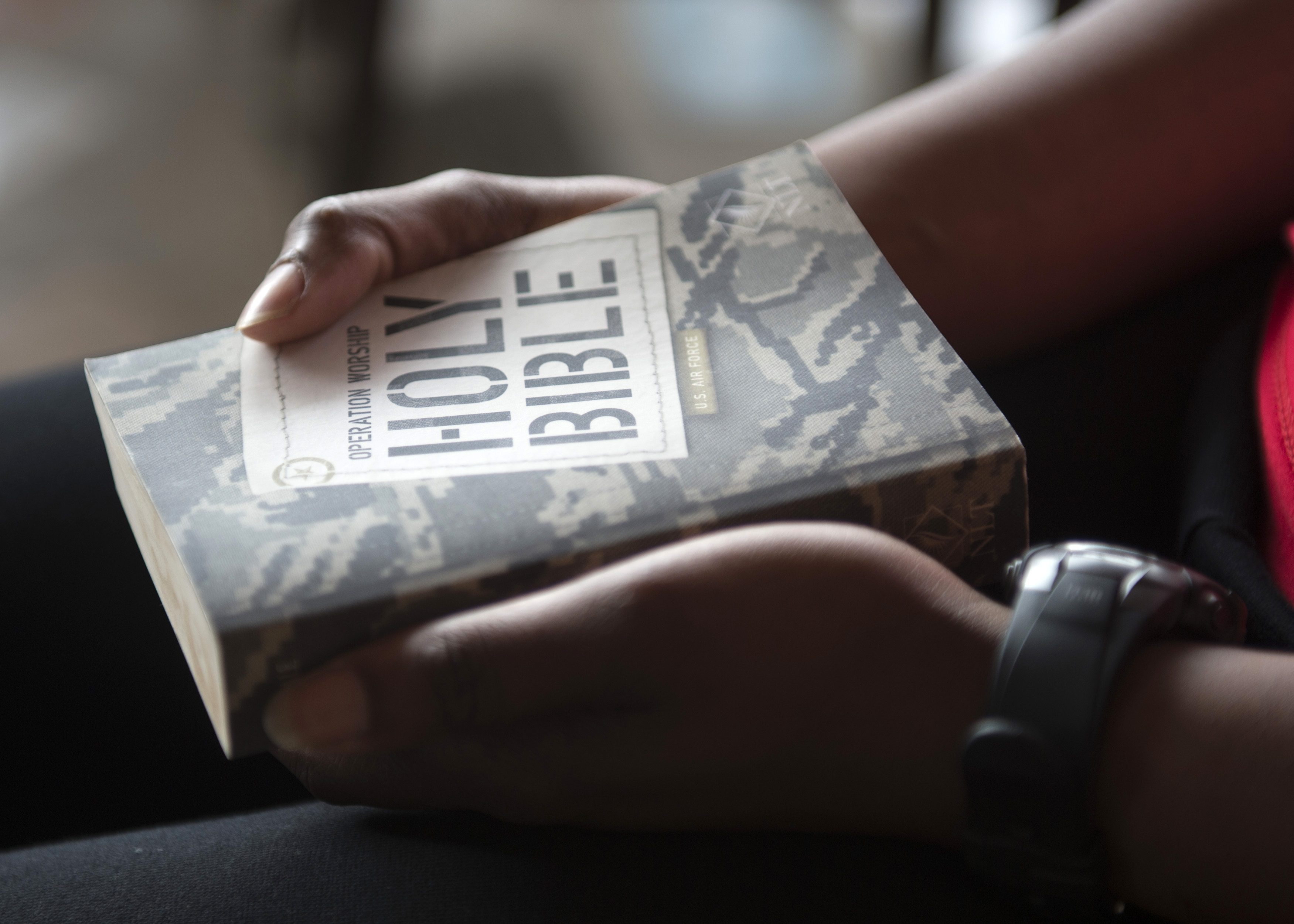 A Combined Joint Task Force-Horn of Africa service member holds a Bible during an Easter service provided by a CJTF-HOA Chaplain on Apr. 5, 2015 for members in the CJTF-HOA area of responsibility. CJTF-HOA Chaplains visit members throughout the CJTF-HOA area of responsibility at least once a month to provide religious services and encouragement. (U.S. Air Force photo by Staff Sgt. Kevin Iinuma)