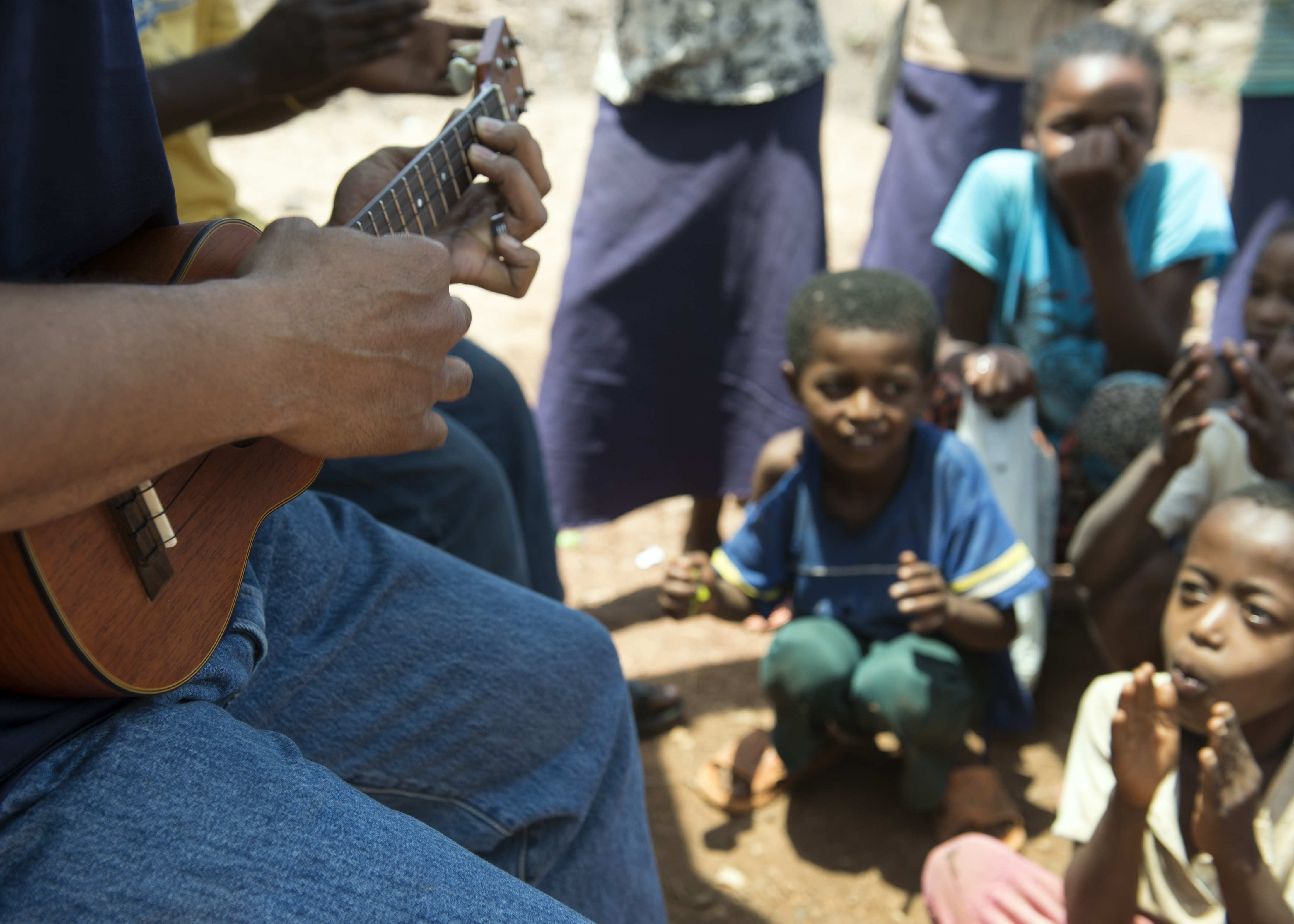 U.S. Army Chaplain (Maj.) Lawrence Allison, Combined Joint Task Force-Horn of Africa Religious Affairs deputy director, plays the ukulele to group of orphans in East Africa, Apr. 3, 2015.  Allison played several Hawaiian songs to entertain and boost the morale of the children. (U.S. Air Force photo by Staff Sgt. Kevin Iinuma)