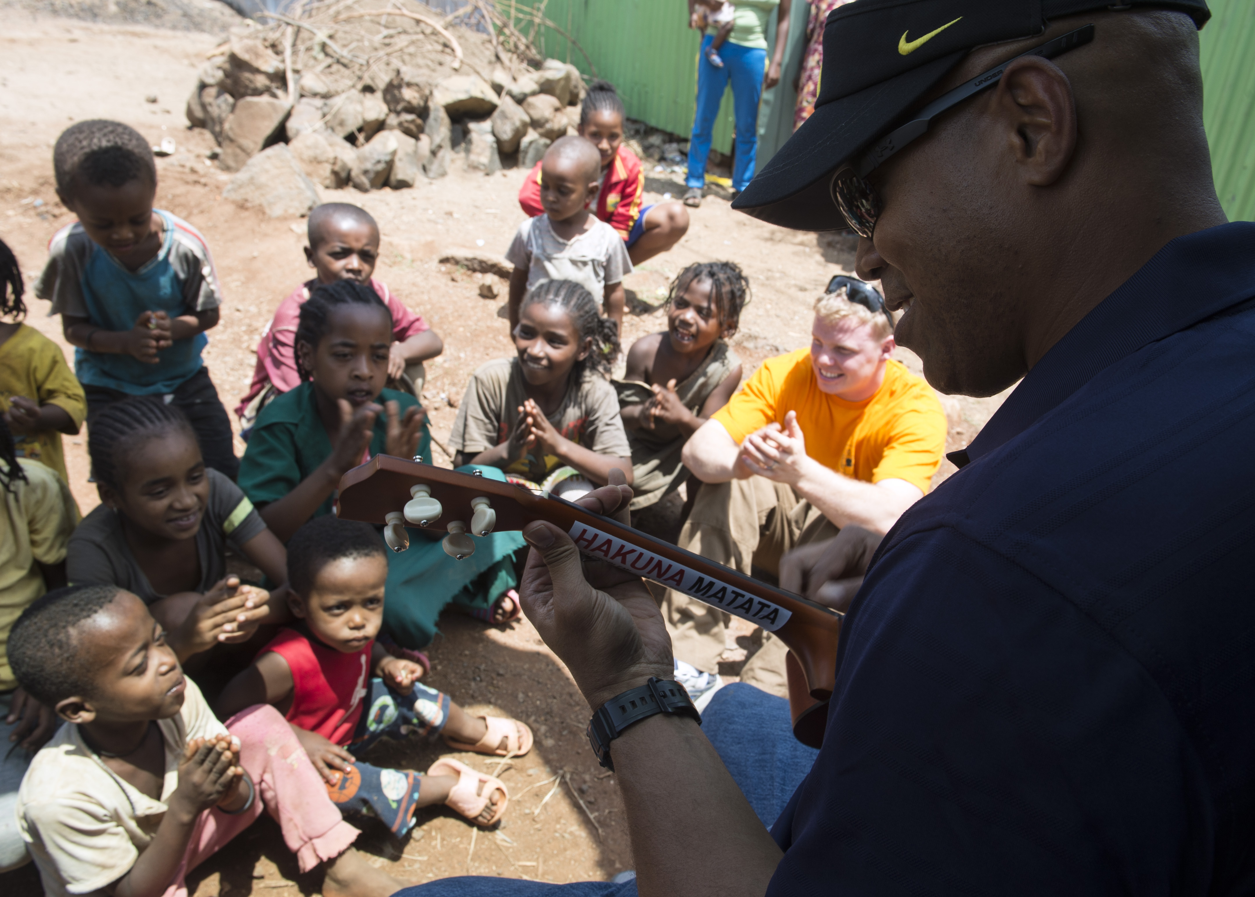 U.S. Army Chaplain (Maj.) Lawrence Allison, Combined Joint Task Force-Horn of Africa Religious Affairs deputy director, plays the ukulele to a group of orphans in East Africa, Apr. 3, 2015.  Allison played several Hawaiian songs to entertain and boost the morale of the children. (U.S. Air Force photo by Staff Sgt. Kevin Iinuma)