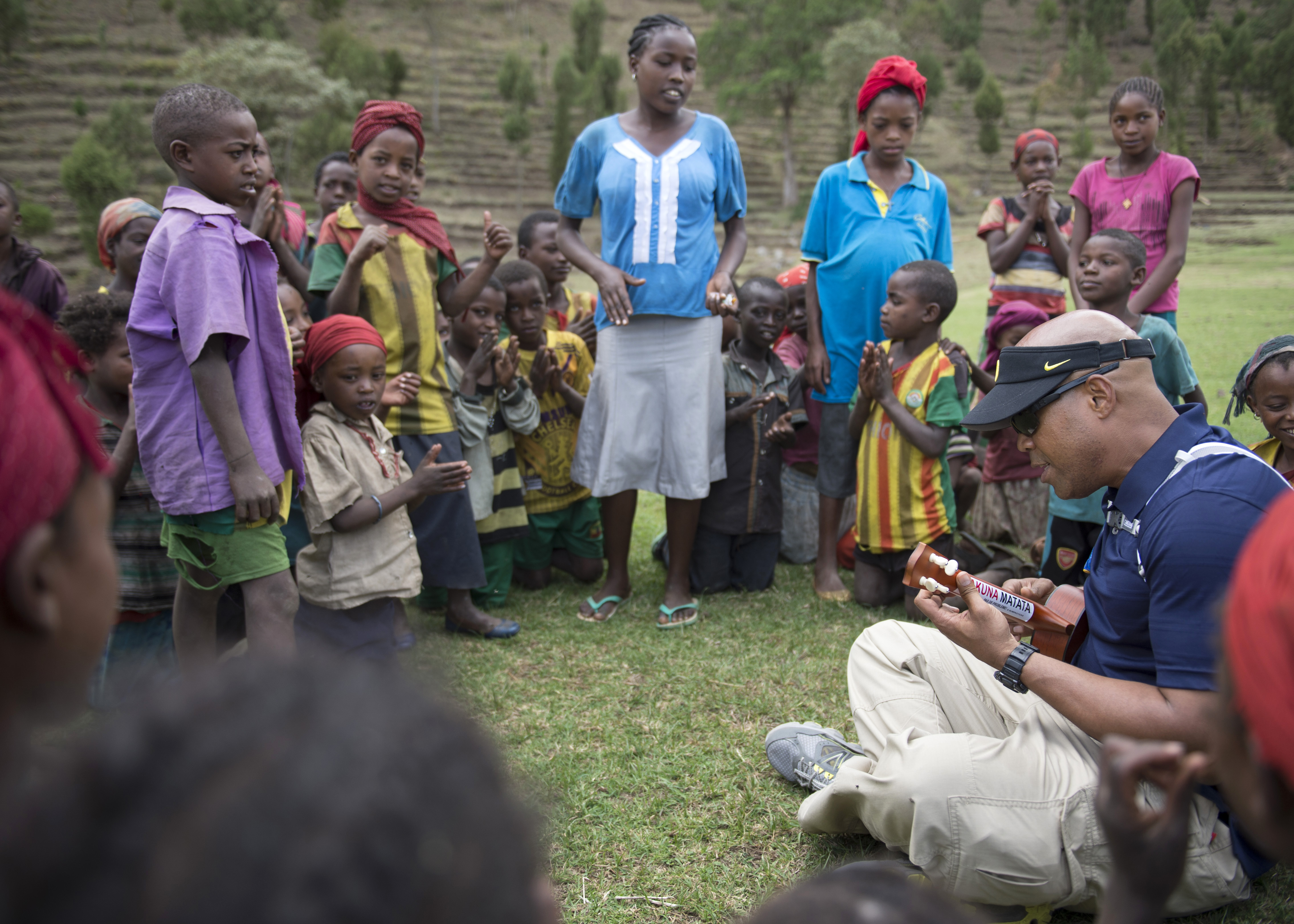 U.S. Army Chaplain (Maj.) Lawrence Allison, Combined Joint Task Force-Horn of Africa Religious Affairs deputy director, plays the ukulele to villagers in East Africa, Apr. 5, 2015.  Allison played several Hawaiian songs to entertain and boost the morale of the children. (U.S. Air Force photo by Staff Sgt. Kevin Iinuma)