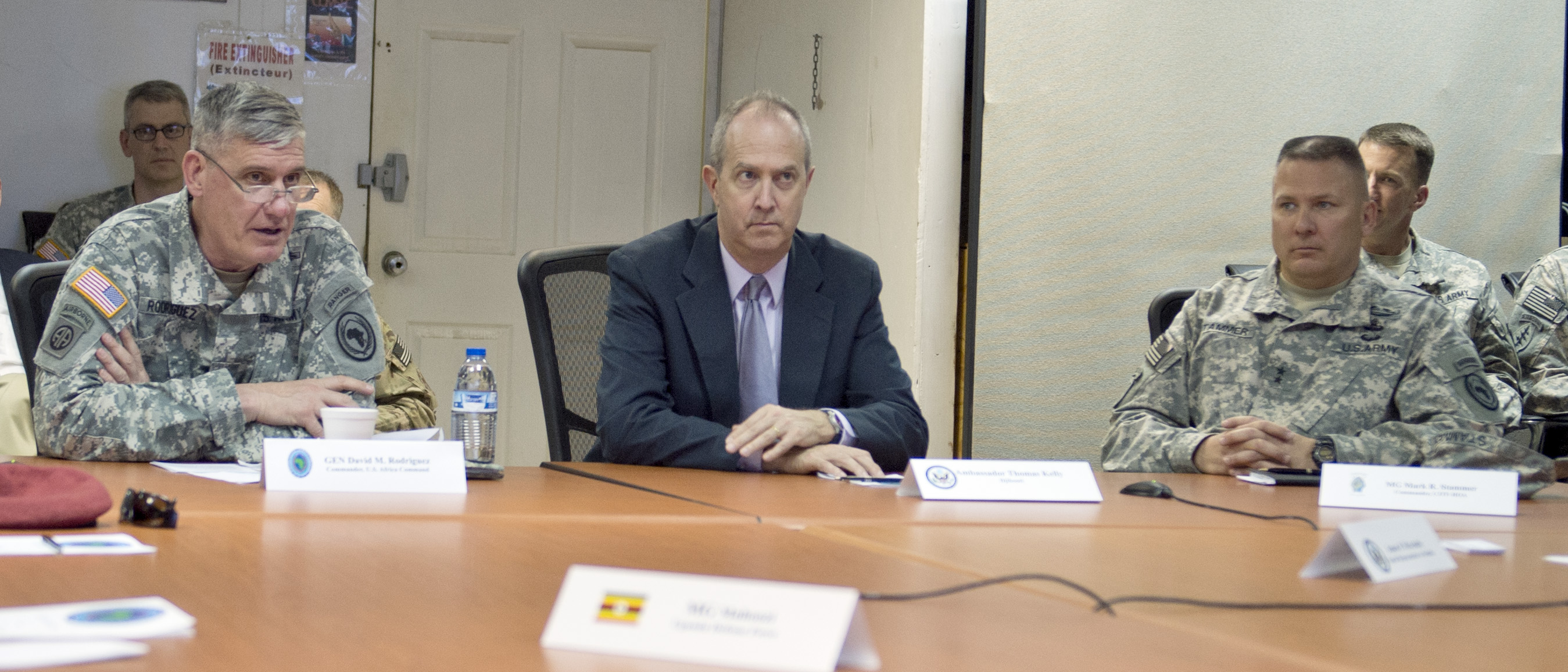 From left, U.S. Army General David Rodriguez, U.S. Africa Command commander, speaks with Ambassador Tom Kelly, U.S. Ambassador of Djibouti, and U.S. Army Maj. Gen. Mark Stammer, Combined Joint Task Force-Horn of Africa commanding general, during the U.S. Africa Command East Africa Joint Interagency, Intergovernmental, and Multinational conference at Camp Lemonnier, Djibouti, April 14, 2015.  The event was a forum for regional U.S. Embassy and East African partner nation representatives to gain greater insight into each other's goals and objectives within the East Africa region. (U.S. Air Force photo by Staff Sgt. Kevin Iinuma)