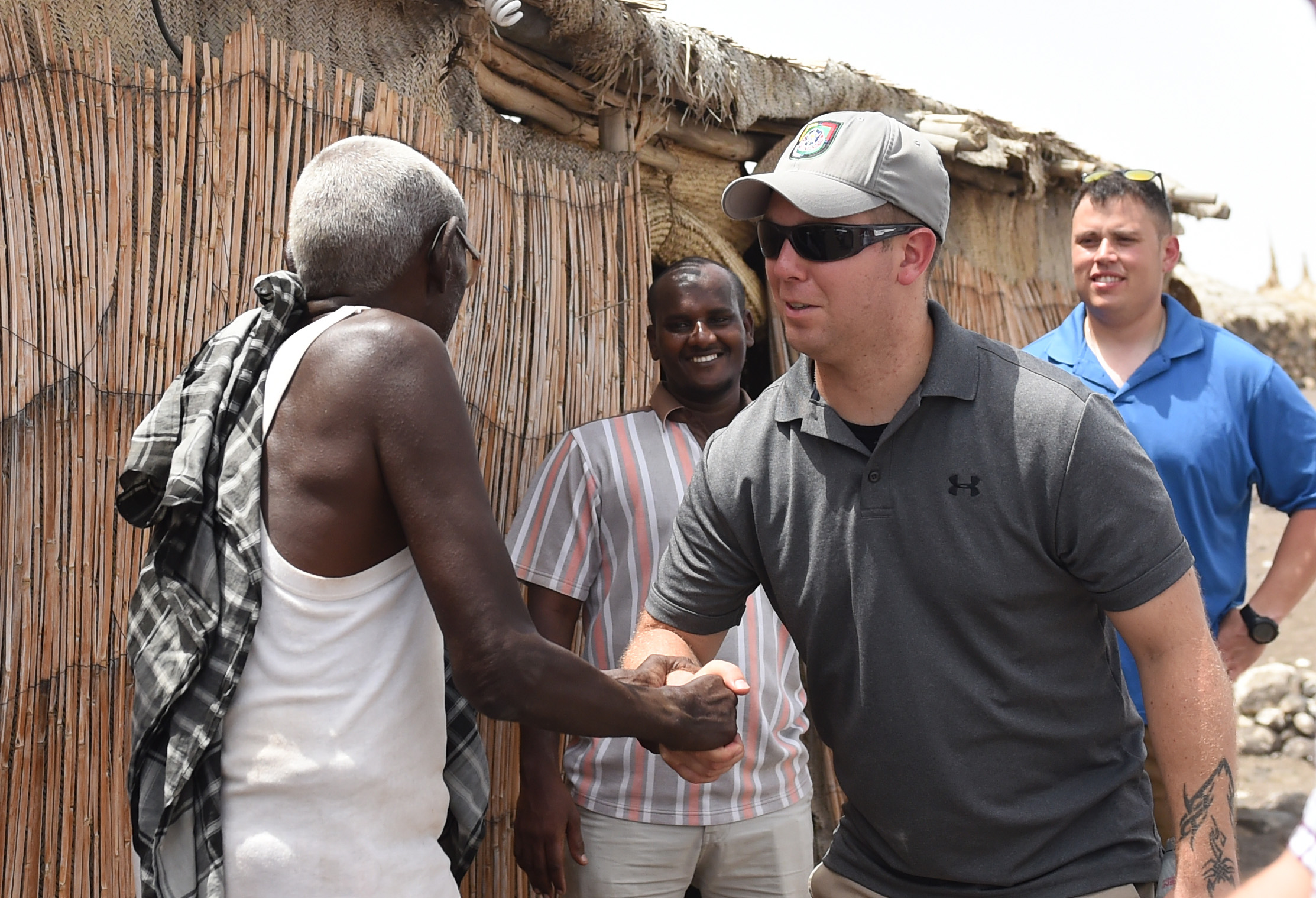 U.S. Army Staff Sgt. Joshua Domalski, 404th Civil Affairs Battalion specialist and medic, shakes a Salt Water Rest Stop village elder's hand upon departing near Lac Abbé, Djibouti, May 20, 2015. Members of the team are assigned to Combined Joint Task Force- Horn of Africa. (U.S. Air Force photo by Senior Airman Nesha Humes
