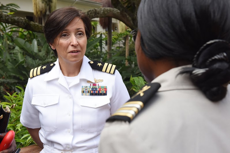 U.S. Navy Cmdr. Kimberly Walz, Combined Joint Task Force-Horn of Africa Theater Security Cooperation deputy director, visits with an African military service member during a Gender Mainstreaming seminar May 19, 2015.  This weeklong seminar focused on how to put words behind actions when it comes to providing equal opportunities for men and women. (U.S. Air Force photo by Staff Sgt. Maria Bowman)