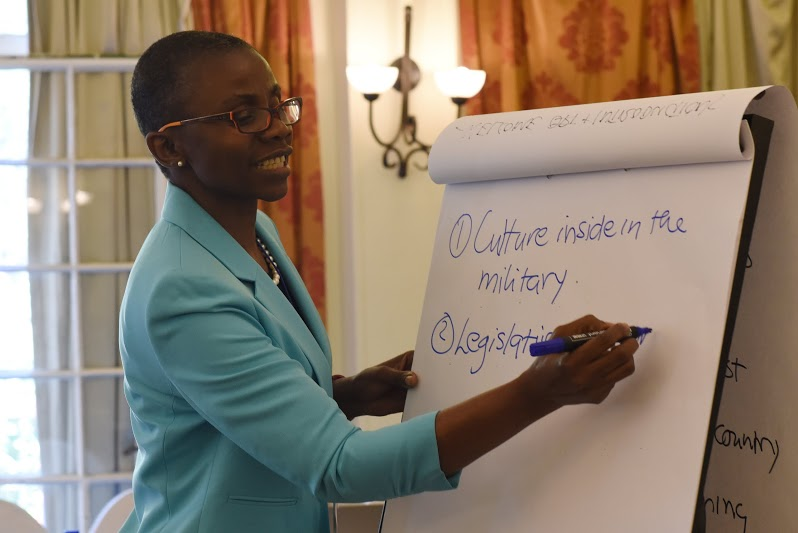 Monde Muyangwa, Woodrow Wilson Center's African Program director, brainstorms gender-related challenges with military personnel and key leaders from U.S. Army Africa and African partner nations during the Gender Mainstreaming Seminar in Arusha, Tanzania, May 19, 2015.  The weeklong seminar brought together 90 attendees from 167 nations to talk about strategies and solutions to implement policies that will allow women and men to benefit equally while not perpetuating inequality.  (U.S. Air Force photo by Staff Sgt. Maria Bowman)