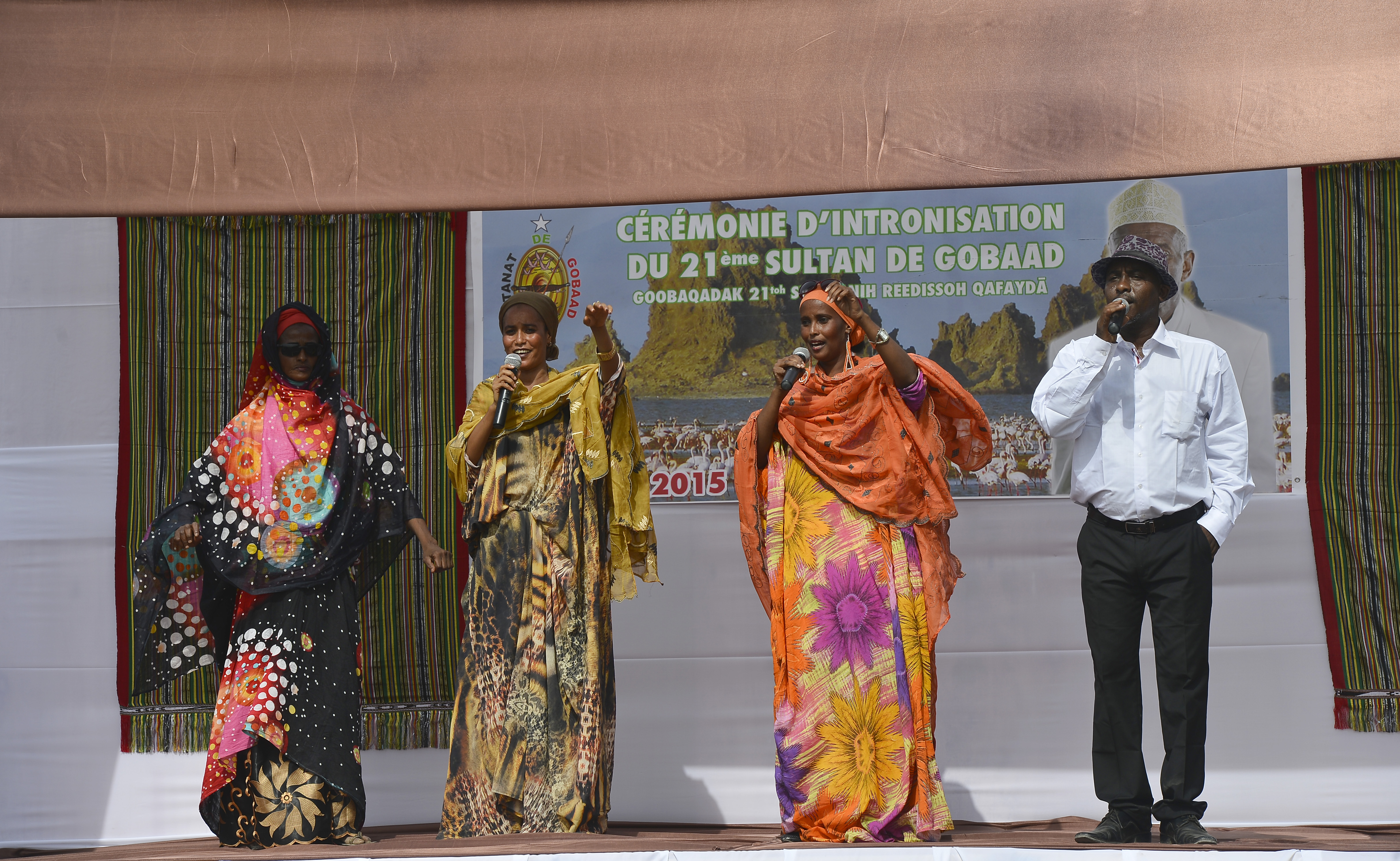 Singers perform at the 21st Induction Ceremony of the Sultan of Gobaad in Dikhil, Djibouti, May 22, 2015. Members of the U.S. Army's 404th Civil Affairs Battalion, assigned to Combined Joint Task Force-Horn of Africa, attended the historical event. (U.S. Air Force photo by Senior Airman Nesha Humes)