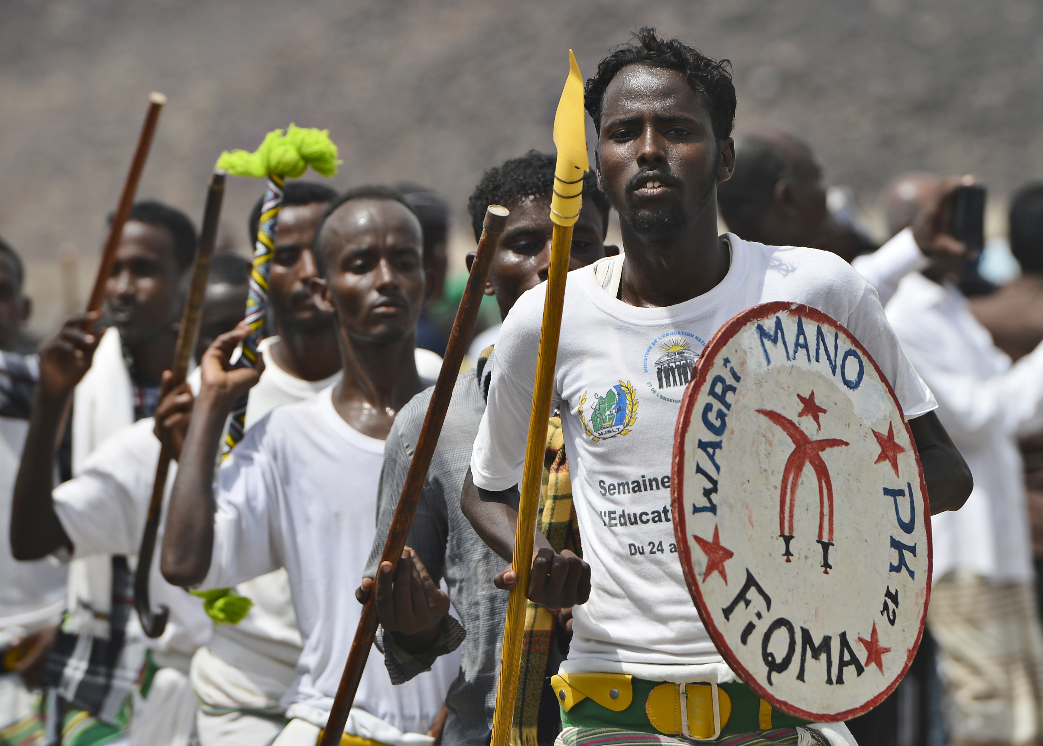 Djiboutian men march with spears and shield during the 21st Induction Ceremony of the Sultan of Gobaad in Dikhil, Djibouti, May 22, 2015. Afar and Issa people sang and danced in traditional apparel to showcase the culture's roots. (U.S. Air Force photo by Senior Airman Nesha Humes)