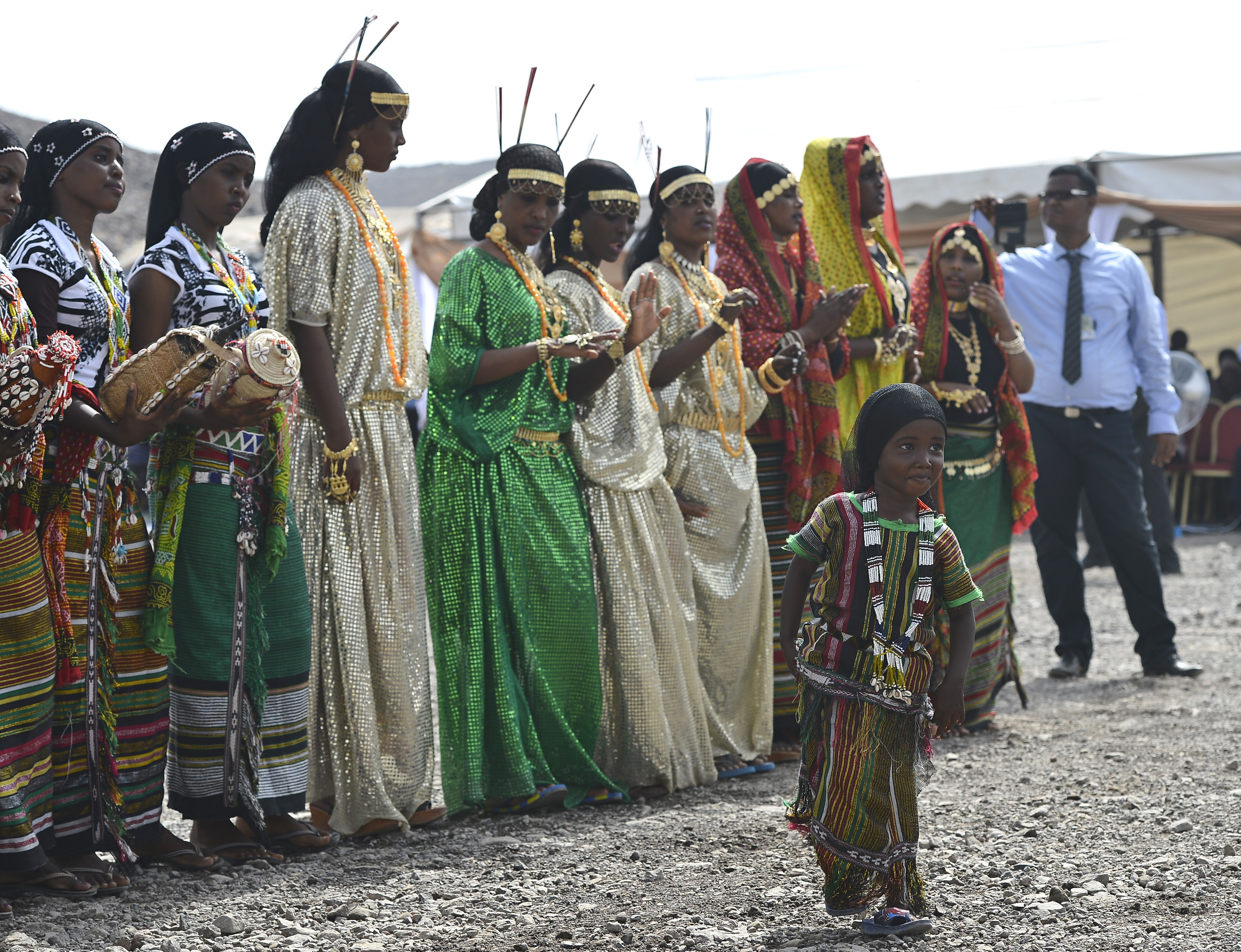 Djiboutian women dressed in traditional Afar and Issa tribal attire, dance at the 21st Induction Ceremony of the Sultan of Gobaad in Dikhil, Djibouti, May 22, 2015. The tribes' culture has primarily dominated customs throughout Djibouti's history. (U.S. Air Force photo by Senior Airman Nesha Humes)