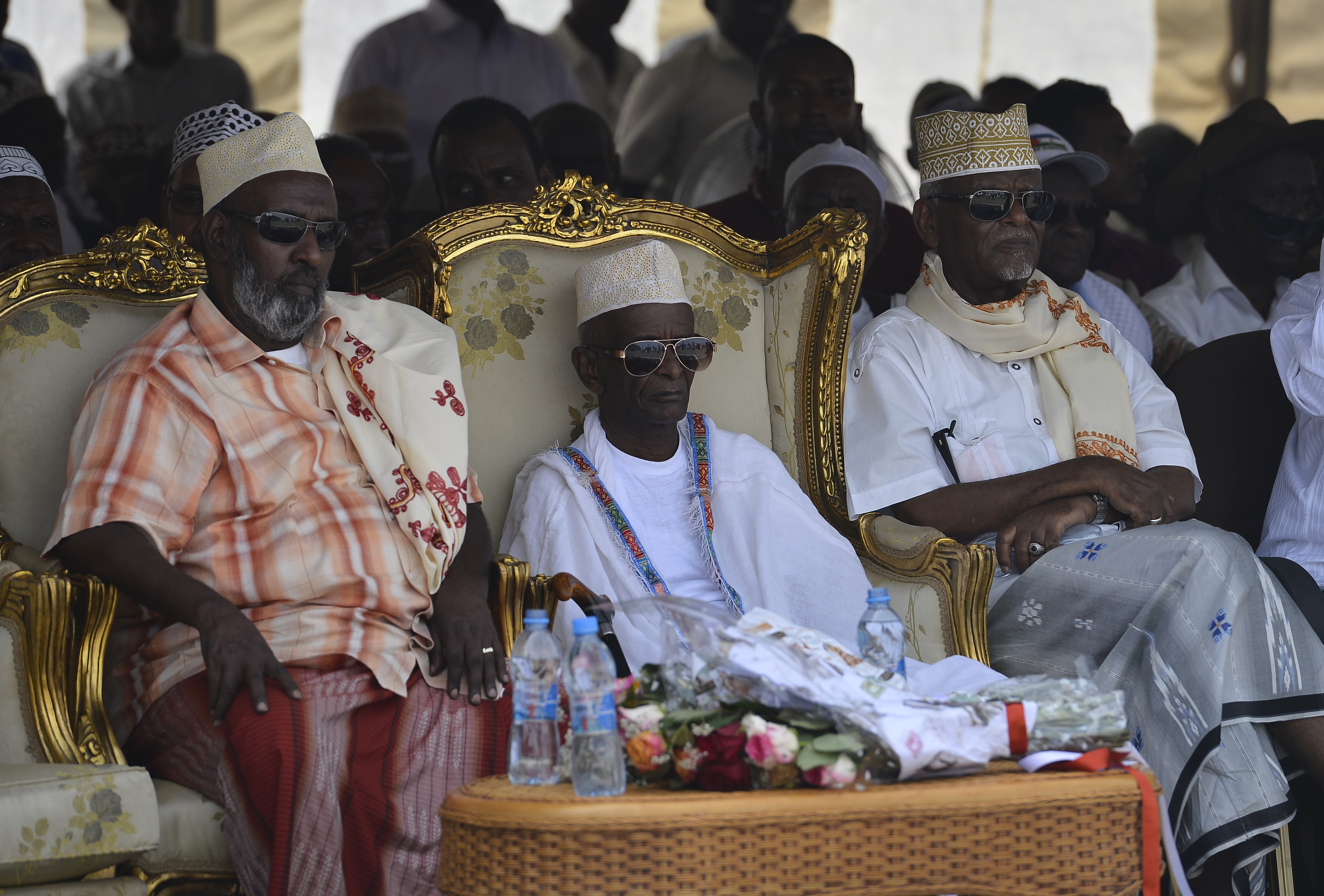"Habib Mohamed Loita, the 21st Sultan of Gobaad, center, watches entertainment provided during his induction ceremony in Dikhil, Djibouti, May 22, 2015. ""Boko Habib,"" as the community calls him, succeeded his late brother Ali Mohamed Loita, and serves as the mediator between the government and the people. (U.S. Air Force photo by Senior Airman Nesha Humes)"