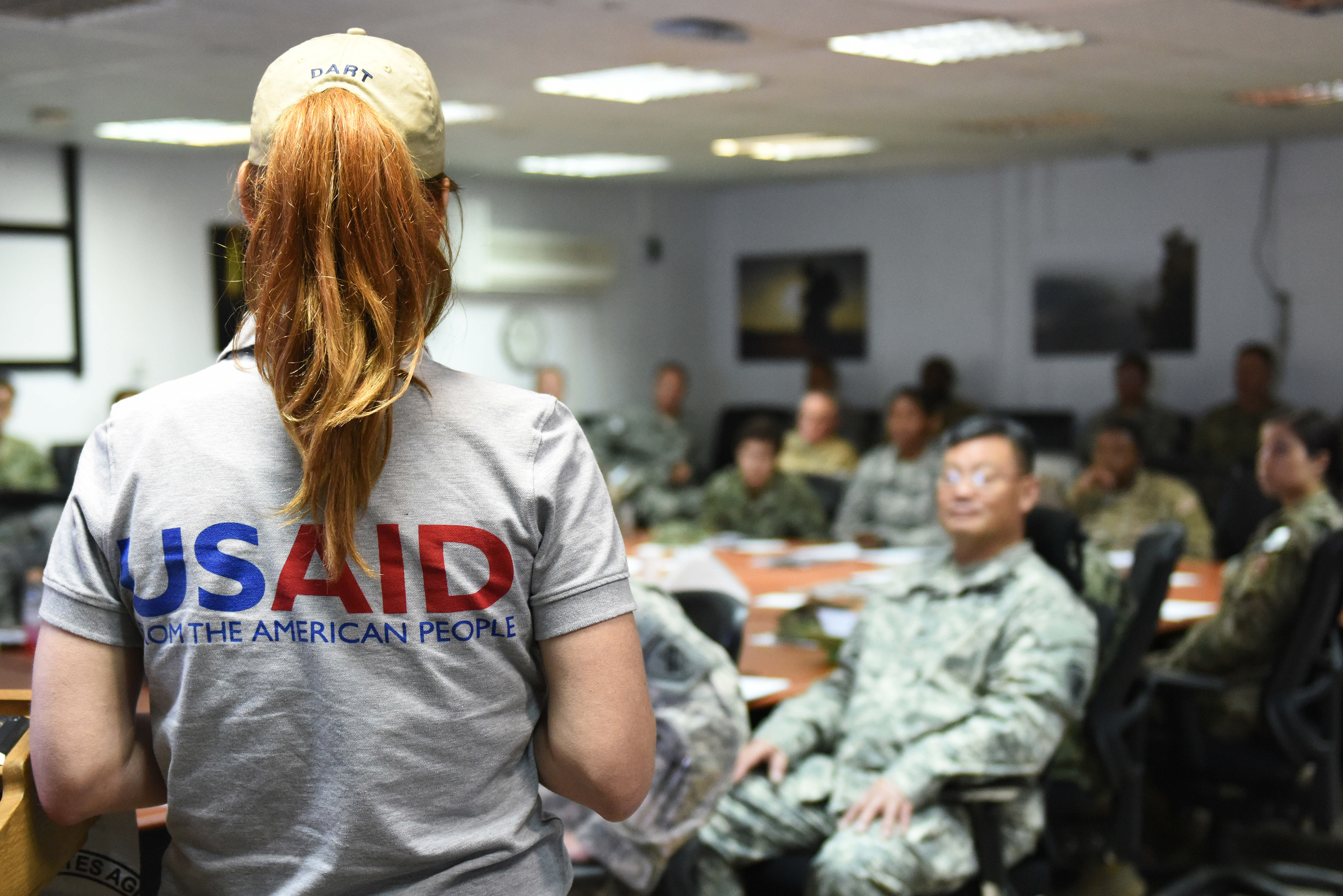Micaela White, Africa Command humanitarian assistance advisor instructs a joint humanitarian operations course at Camp Lemonnier, Djibouti June 1, 2015.  Course attendees learned about the relationship between USAID's Office of U.S. Foreign Disaster Assistance, its partners and the U.S. military, and learned about humanitarian assistance and disaster response operations.  (U.S. Air Force photo by Staff Sgt. Maria Bowman)