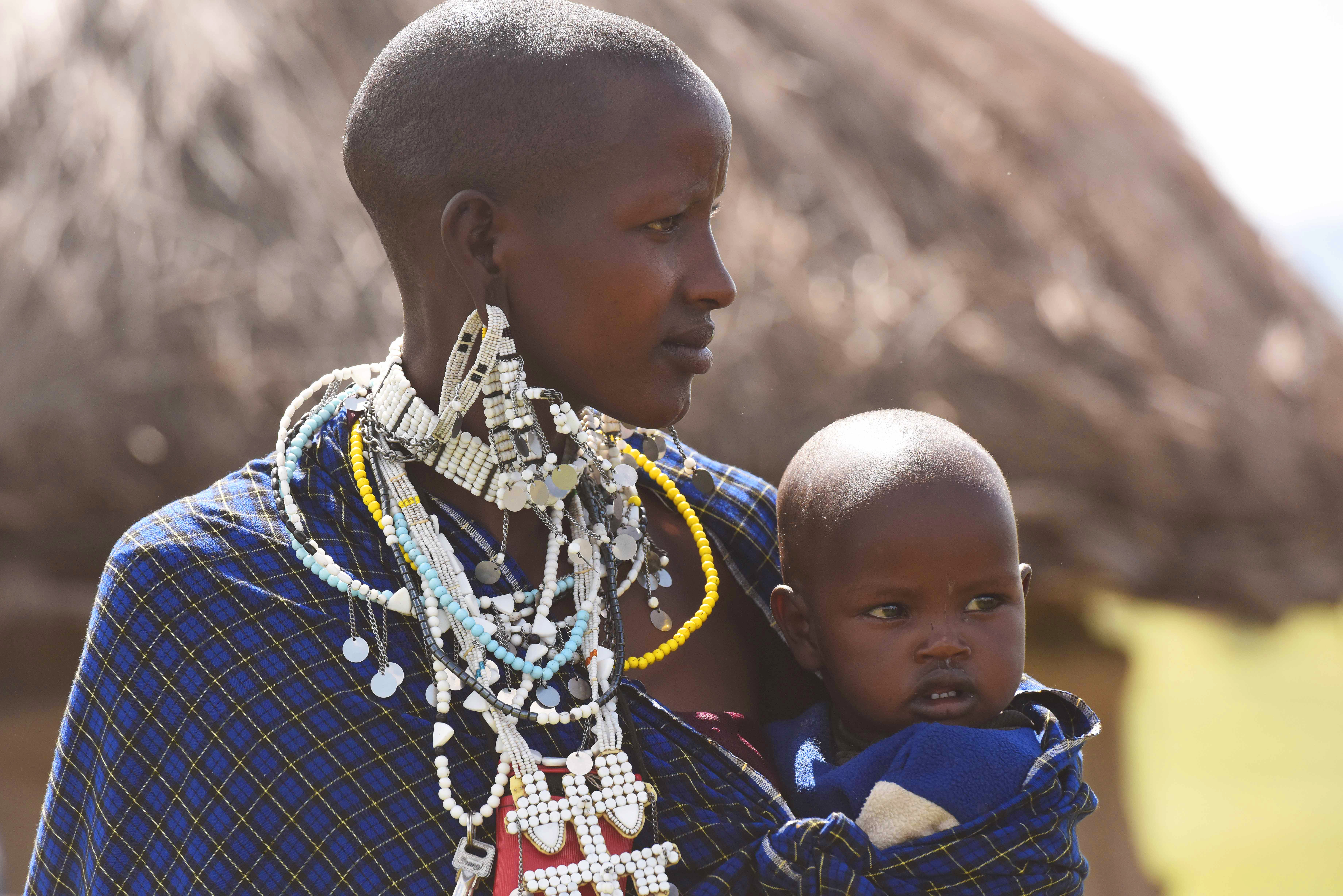 A mother from the Maasai tribe holds her child May 21, 2015.  During a culture day of a Gender Mainstreaming seminar, attendees visited the Maasai Village to experience their culture, traditions and lifestyle. (U.S. Air Force photo by Staff Sgt. Maria Bowman)