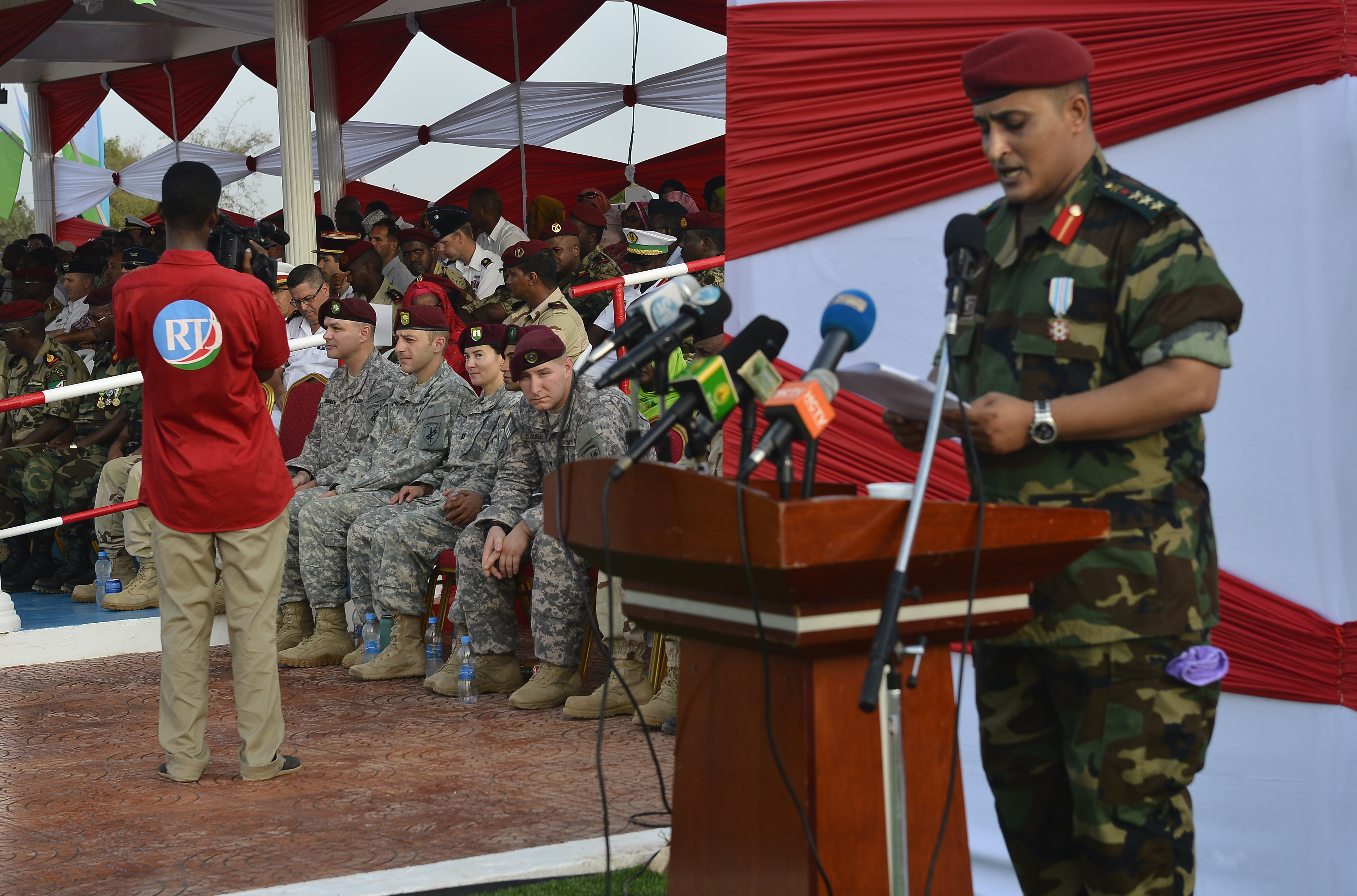 U.S. Army Soldiers assigned to Combined Joint Task Force-Horn of Africa, listen to a speaker during the Djiboutian Armed Forces' (FAD) 38th anniversary celebration June 6, 2015 at Camp Cheik Osman, Djibouti.  The FAD invited its partner nations to celebrate the creation of the FAD while observing the pride and professionalism of Djibouti's service members. (U.S. Air Force photo by Senior Airman Nesha Humes)