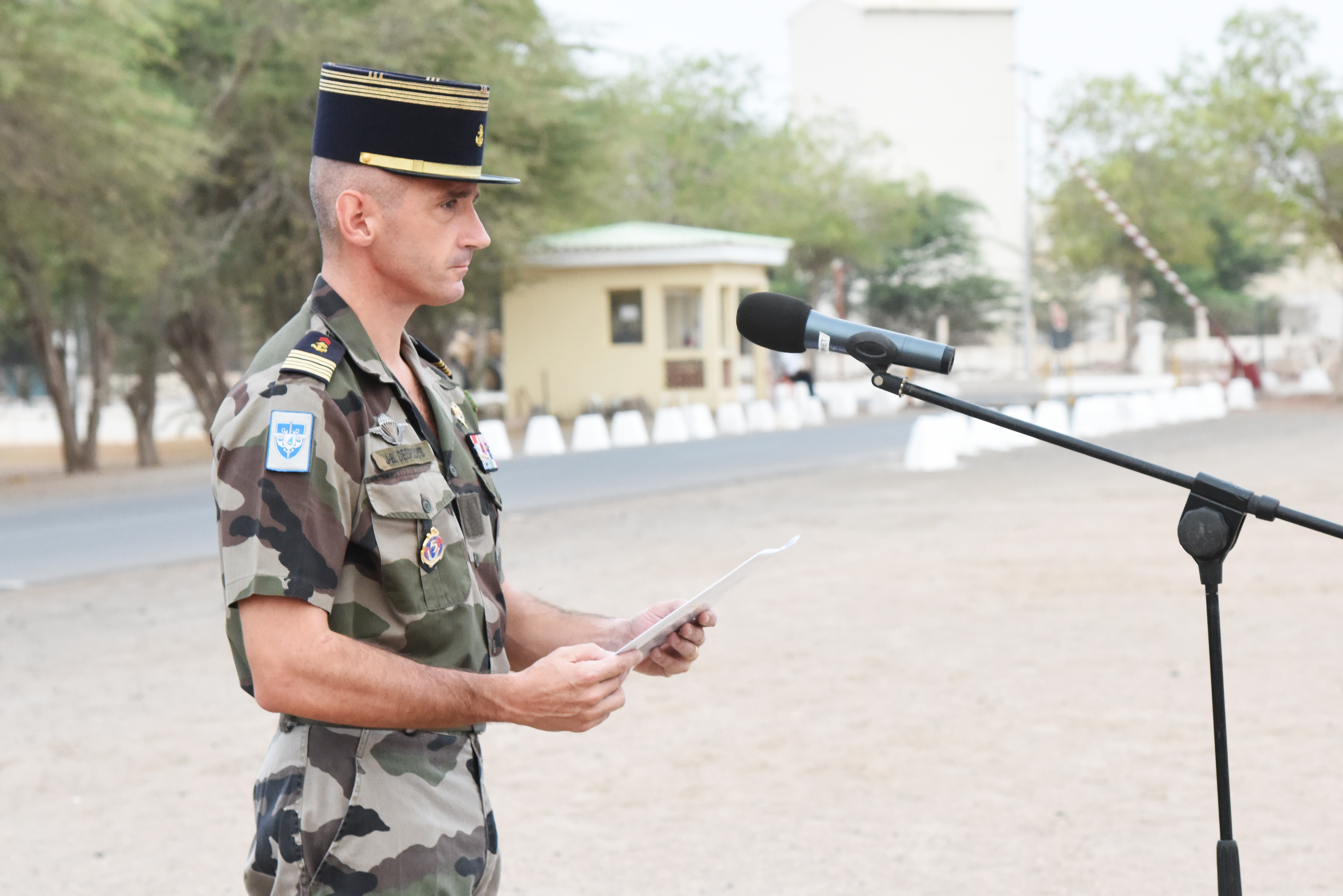 French Marine Col. Jean-Bruno Despouys, 5th Marines commanding officer, addresses French and U.S. troops during an award ceremony at a Naval base in Djibouti, June 11, 2015.  Three U.S. Army soldiers received the French National Defense Medal (Silver Level) for saving the life of a French service member during a motor vehicle accident Feb. 27, 2015.  (U.S. Air Force photo by Staff Sgt. Maria Bowman)
