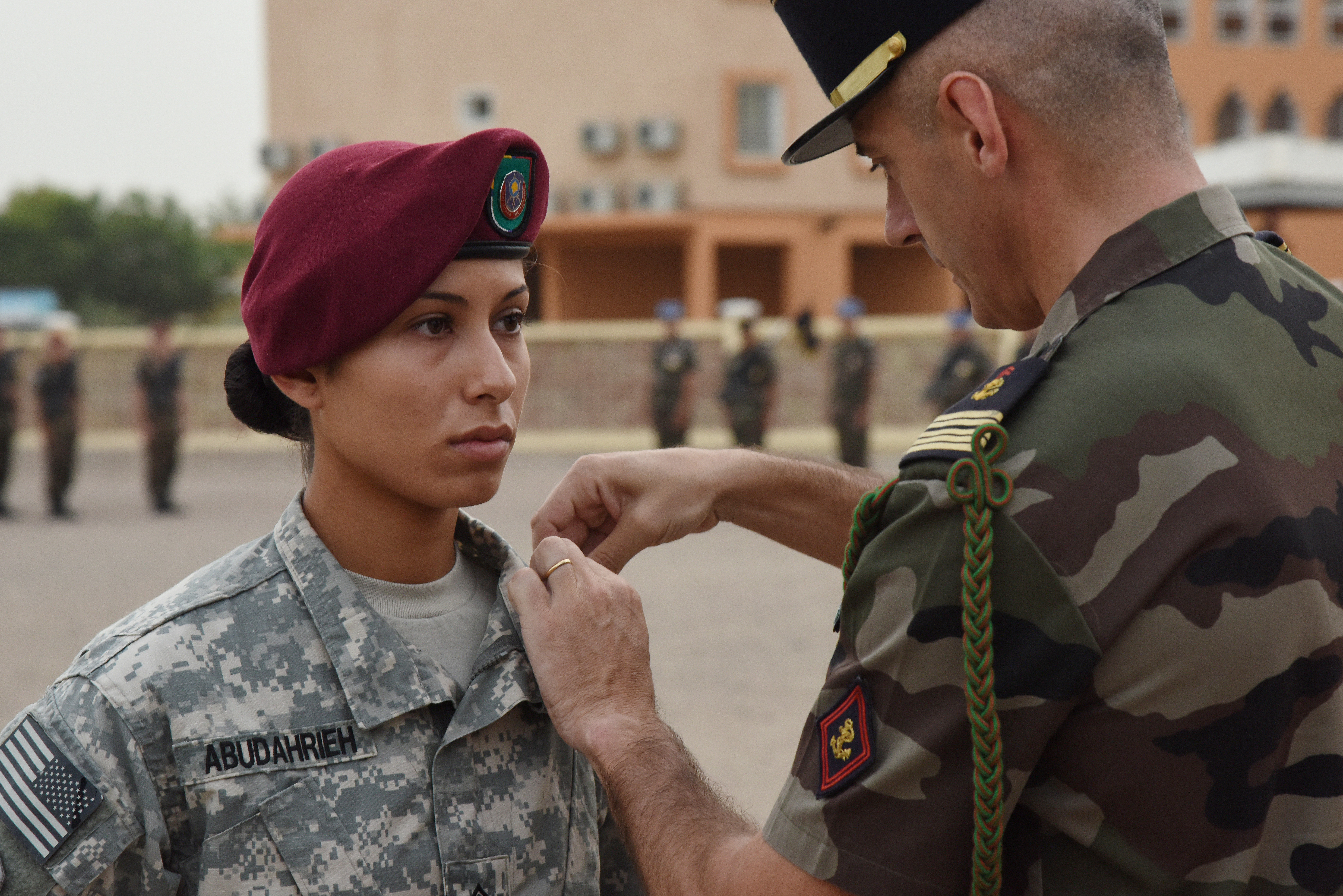 U.S. Army Sgt. Rawan Abudahrieh receives a National Defense Medal during an award ceremony at a Naval base in Djibouti, June 11, 2015, due to his life-saving medical care to a French service member during a catastrophic motor vehicle accident in February.  (U.S. Air Force photo by Staff Sgt. Maria Bowman)