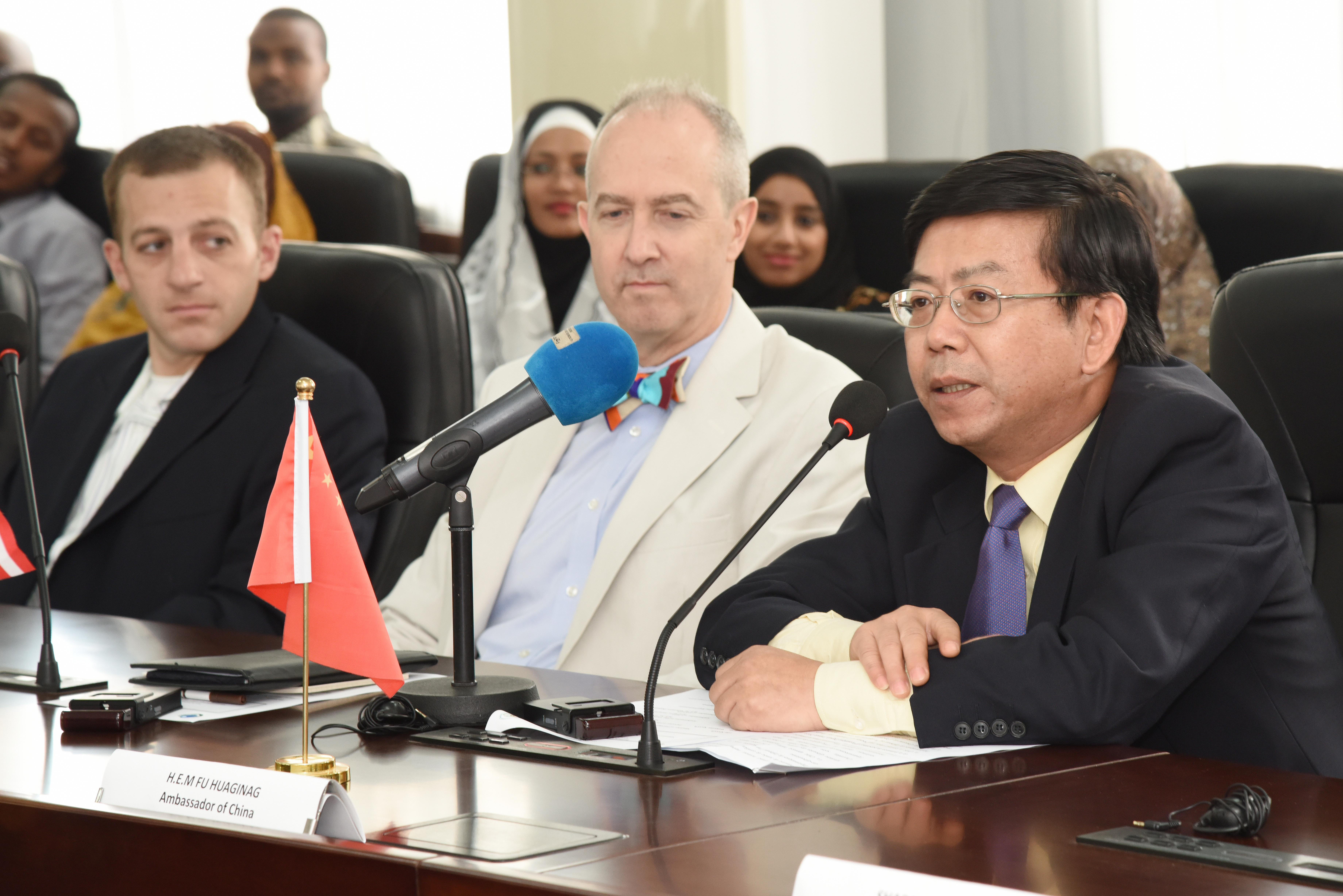Fu Huaginag, Chinese Ambassador to Djibouti, addresses honored guests and foreign language students during a graduation ceremony at the Institute of Diplomatic Studies in Djibouti, June 14, 2015.  The graduates have spent the last academic year studying English, Chinese or Amharic.  (U.S. Air Force photo by Staff Sgt. Maria Bowman)