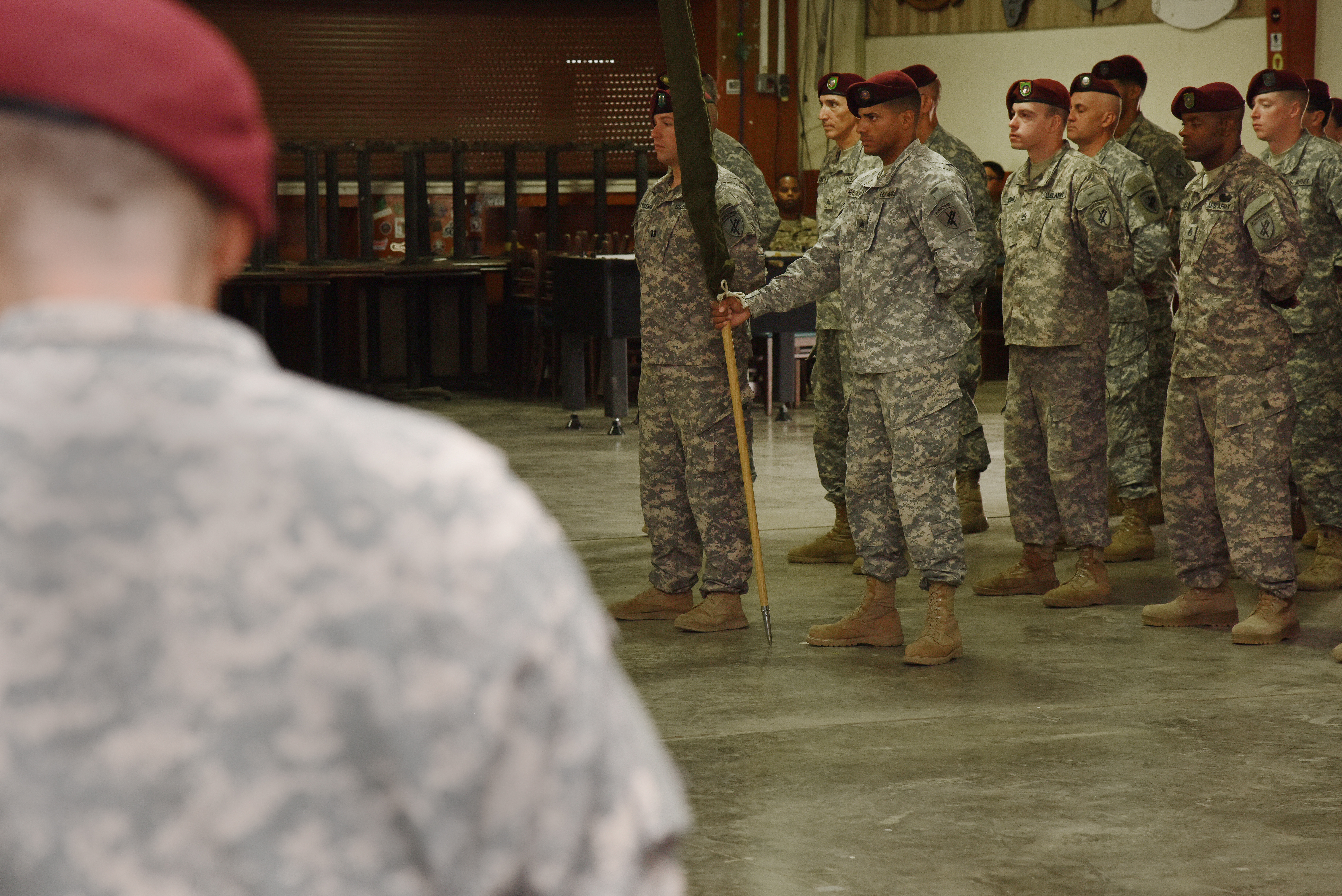 The 404th Civil Affairs Battalion soldiers listen to U.S. Army Lt. Col. Timothy Brennan, former Army Civil Affairs Battalion commander, give a speech during a transfer of authority ceremony June 22, 2015, in Djibouti.  The 415th CAB soldiers will take over the responsibilities and tasks that the outgoing CAB performed during their time assigned to Combined Joint Task Force-Horn of Africa.  (U.S. Air Force photo by Staff Sgt. Maria Bowman)