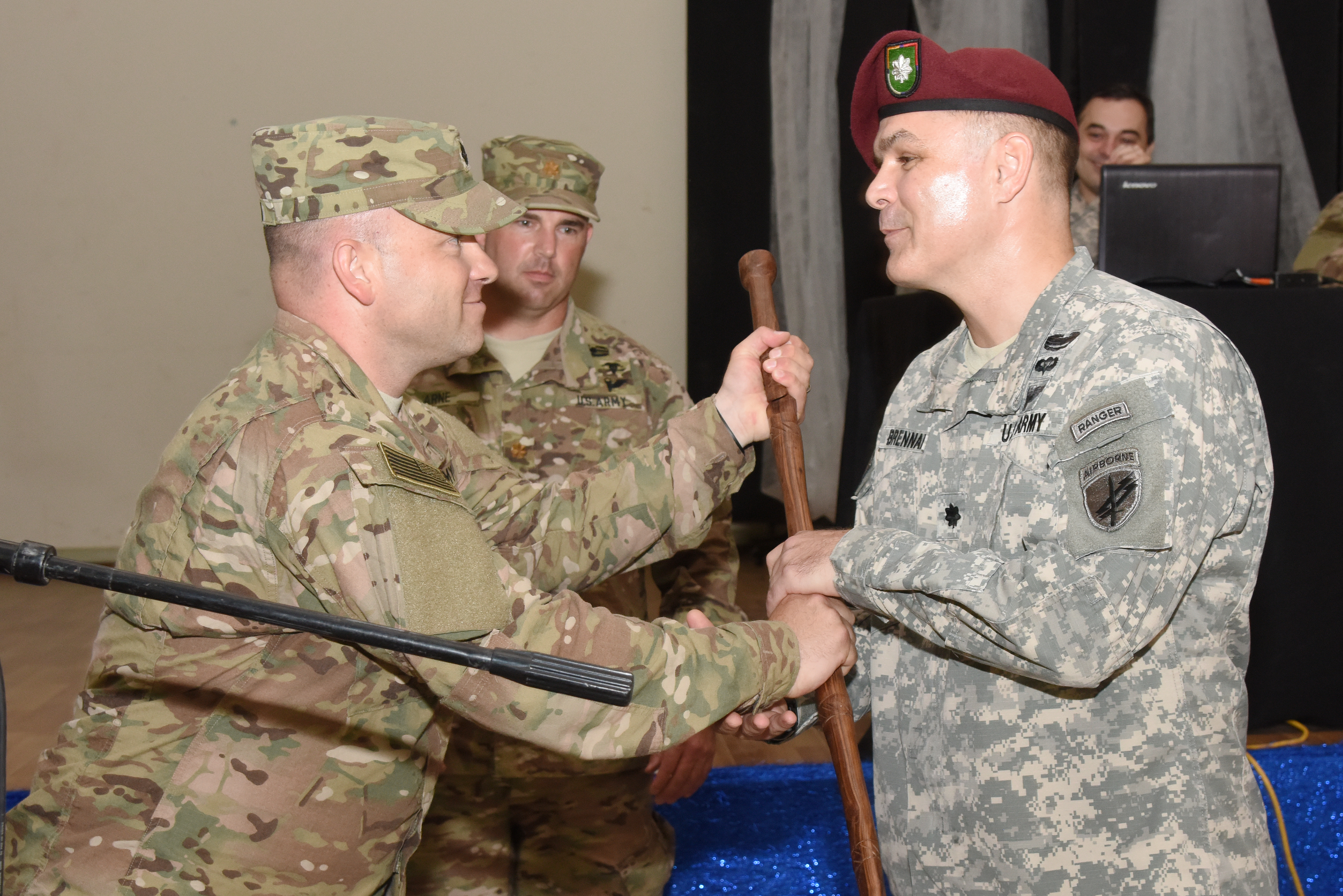 U.S. Army Lt. Col. Gerry Dolan, 415th Civil Affairs Battalion commander, gives a gift to U.S. Army Lt. Col. Timothy Brennan, former Army Civil Affairs Battalion commander, during a transfer of authority ceremony June 22, 2015, in Djibouti.  The 404th CAB soldiers will return to Joint Base McGuire-Dix-Lakehurst, N.J. (U.S. Air Force photo by Staff Sgt. Maria Bowman)