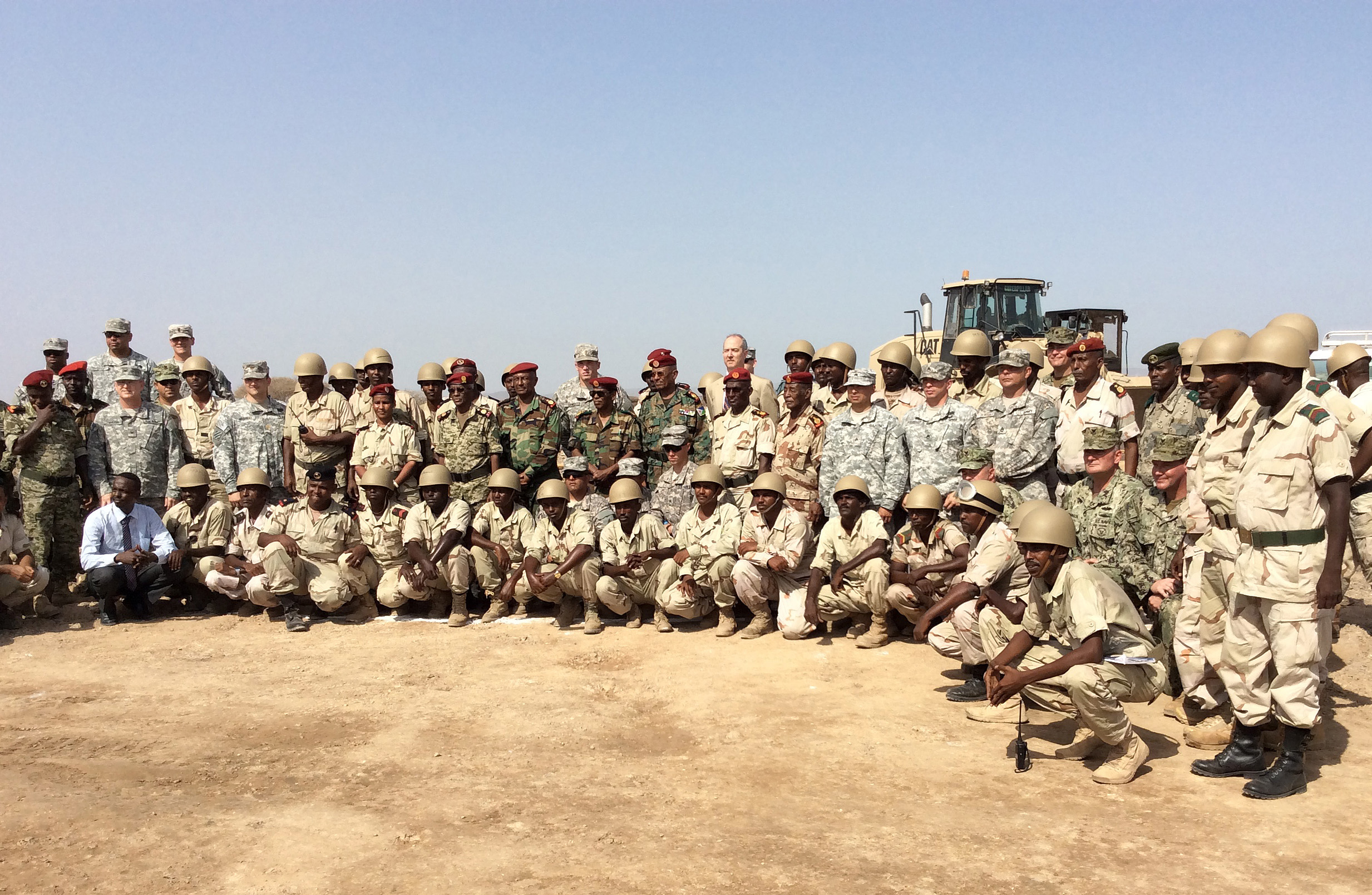 Camp Lemonnier, Djibouti (May 14, 2015) U.S Navy Seabees assigned to Naval Mobile Construction Battalion (NMCB) 14, U.S. Army 47th Transportation Company, and the Djiboutian Army Construction Engineers pose at the culminating event and awards ceremony for a U.S. Army-led Counter Terrorism Logistics and Engineering training evolution. NMCB-14 Detachment HOA is assigned to Camp Lemonnier in support of Combined Joint Task Force–Horn of Africa. (U.S. Navy photo by Lieutenant Junior Grade Stephen Woodham)