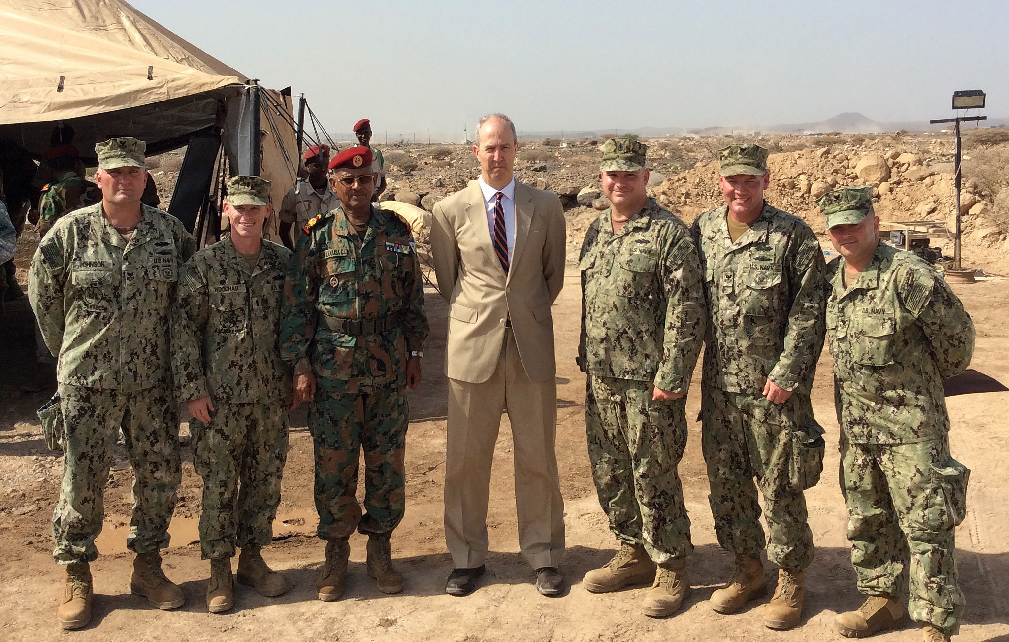 Camp Lemonnier, Djibouti (May 14, 2015) U.S. Navy Seabees of Naval Mobile Construction Battalion (NMCB) 14 pose with the U.S. Ambassador to Djibouti, Tom Kelly and Chief of Djibouti Defense Forces Maj. Gen. Zakaria Cheikh Ibrahim at an awards ceremony for the U.S. Army-led Counter Terrorism Logistics and Engineering training evolution. NMCB-14 Detachment HOA is assigned to Camp Lemonnier in support of Combined Joint Task Force–Horn of Africa. (U.S. Navy photo by Petty Officer 1st Class Douglas Johnson)