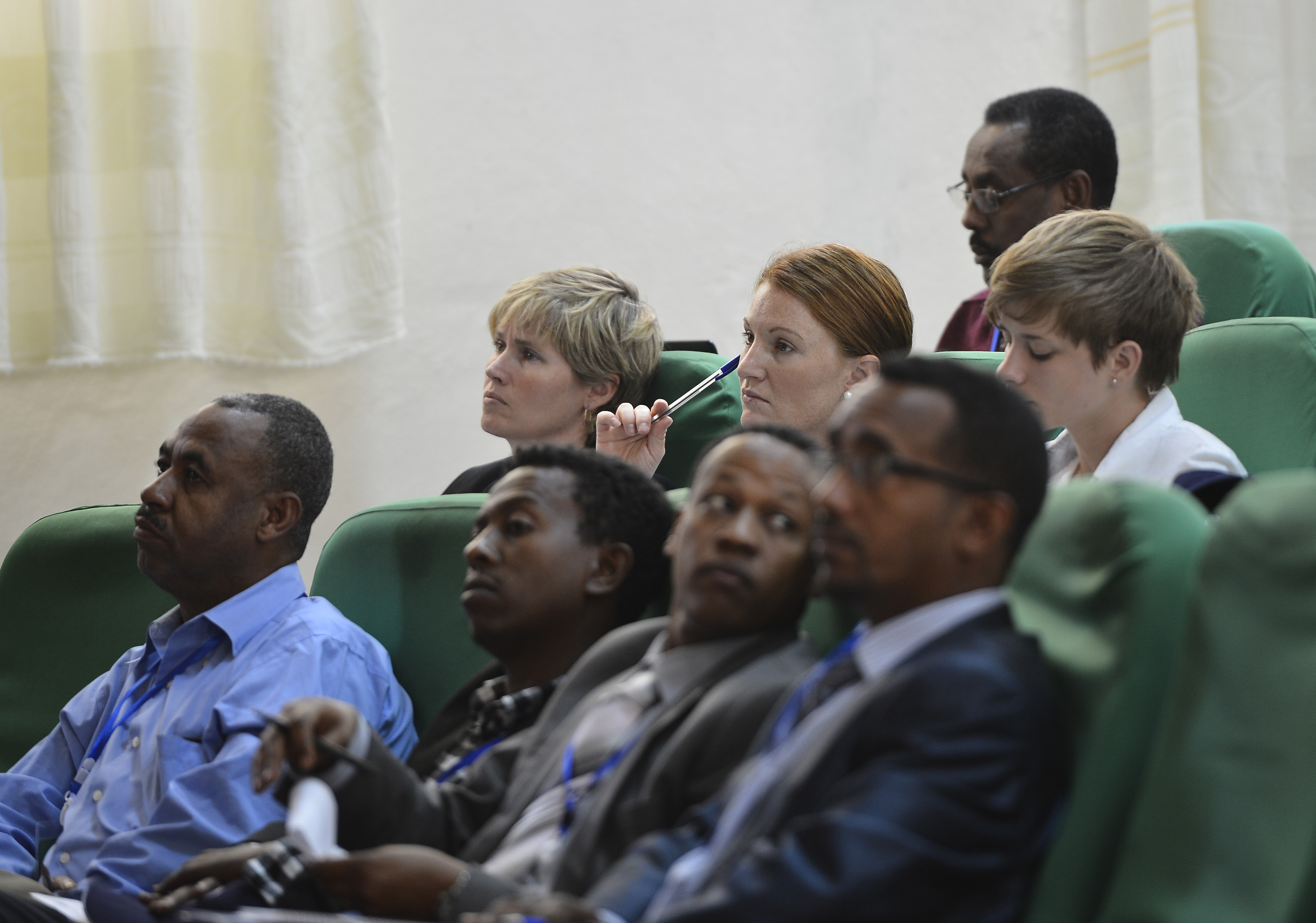 The U.S. Army 404th Civil Affairs Battalion Veterinary Cell Team, assigned to Combined Joint Task Force- Horn of Africa, listen to scientific paper presentations at the Third International Veterinary Education Conference at Haramaya University in Dire Dawa, Ethiopia, June 18, 2015. The conference brought together more than 100 East African policy makers, professors, government officials, students and international partners. (U.S. Air Force photo by. Senior Airman Nesha Humes)
