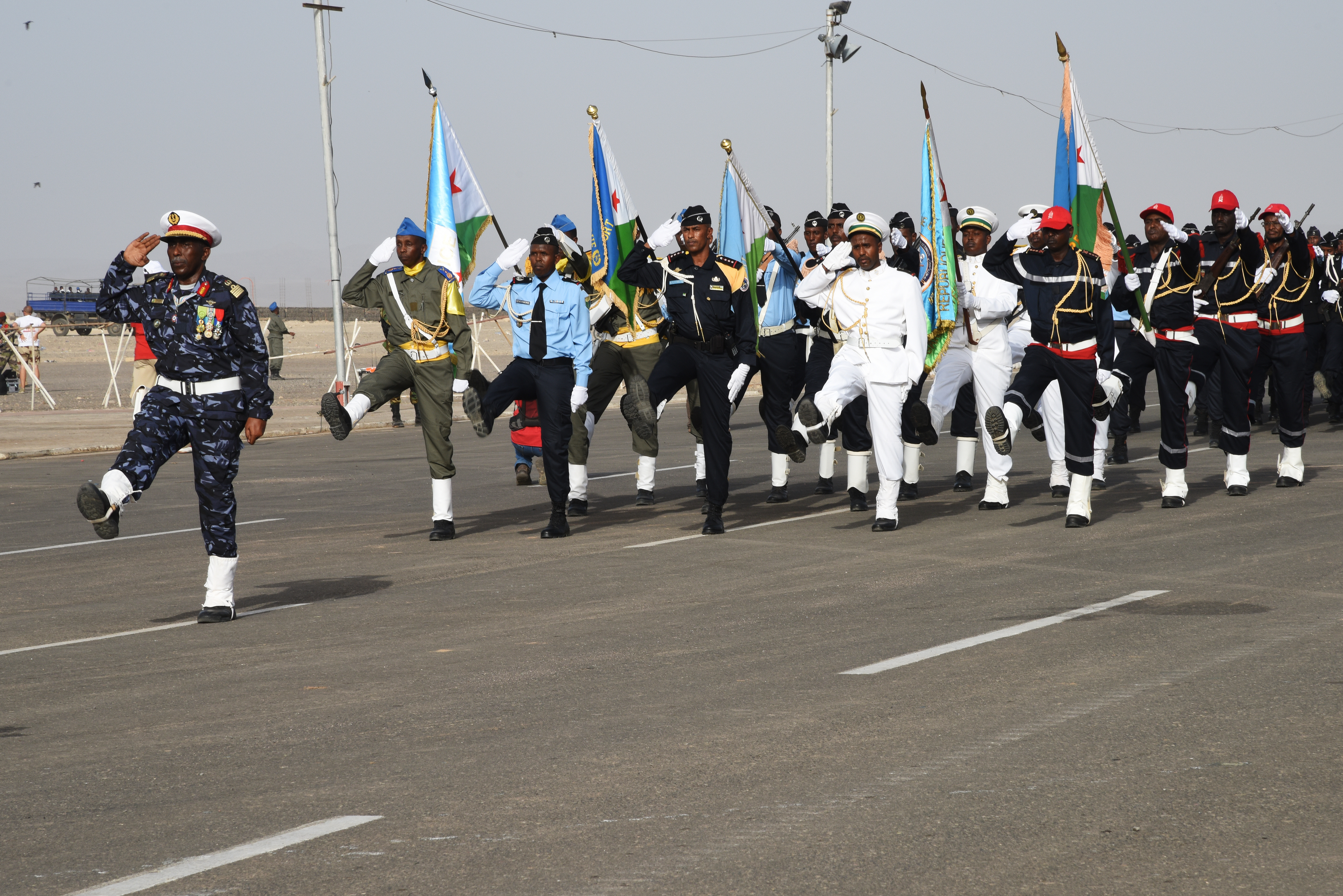 Djibouti's military, law enforcement and civil servants march along a parade route during a Djibouti Independence Day celebration June 27, 2015.  On that day, in 1977, Djibouti gained its independence from France.   (U.S. Air Force photos by Staff Sgt. Maria Bowman)