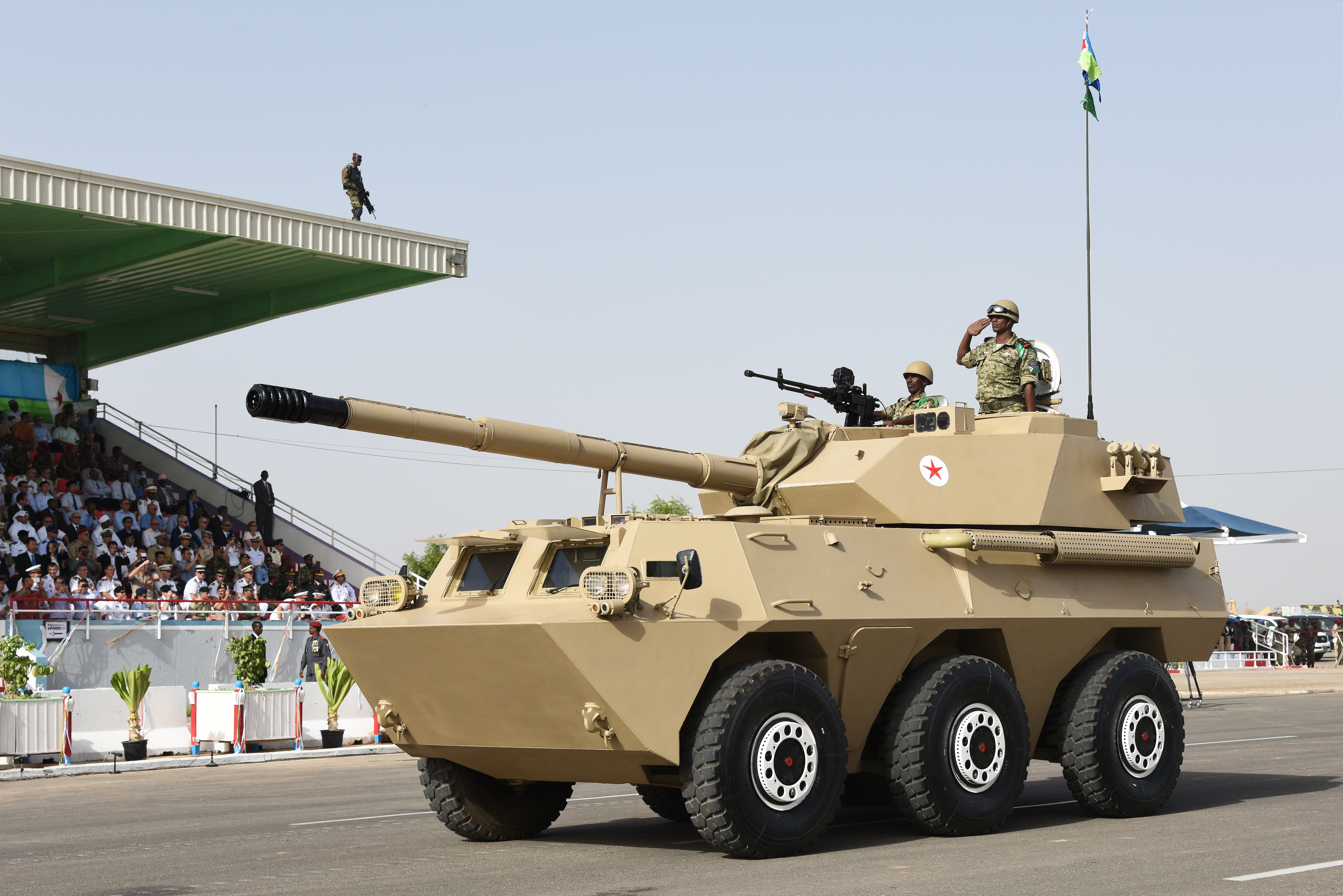 Djibouti's service members drive a military vehicle during a Djibouti Independence Day celebration June 27, 2015.  The military parade included a marching band and troops showcasing its different military equipment.  (U.S. Air Force photo by Staff Sgt. Maria Bowman) (U.S. Air Force photos by Staff Sgt. Maria Bowman)