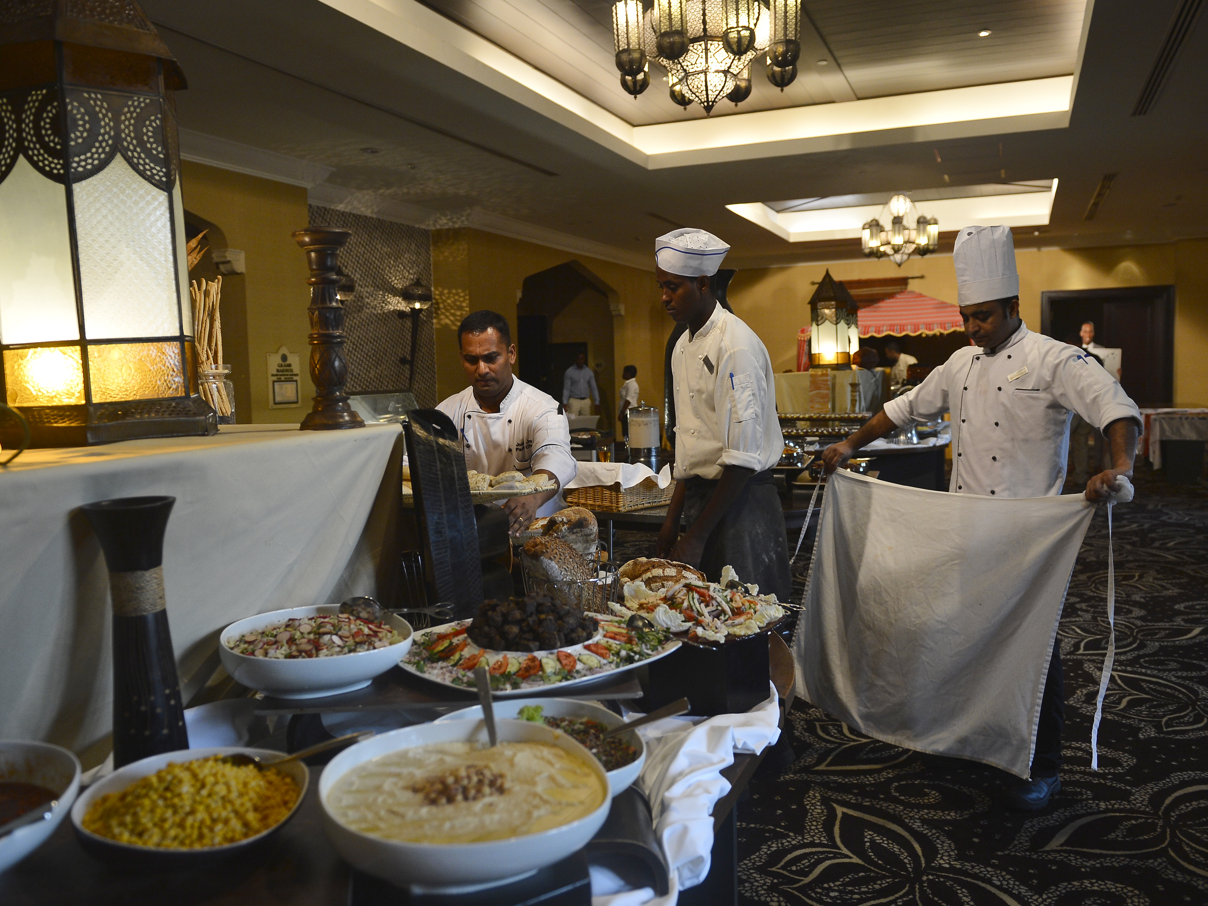 Kempinski Hotel caterers set up for Combined Joint Task Force-Horn of Africa's Iftar dinner in Djibouti, June 29, 2015. Iftar is the fast-breaking meal during the Muslim religious observance of Ramadan.  (U.S. Air Force photo by Senior Airman Nesha Humes)