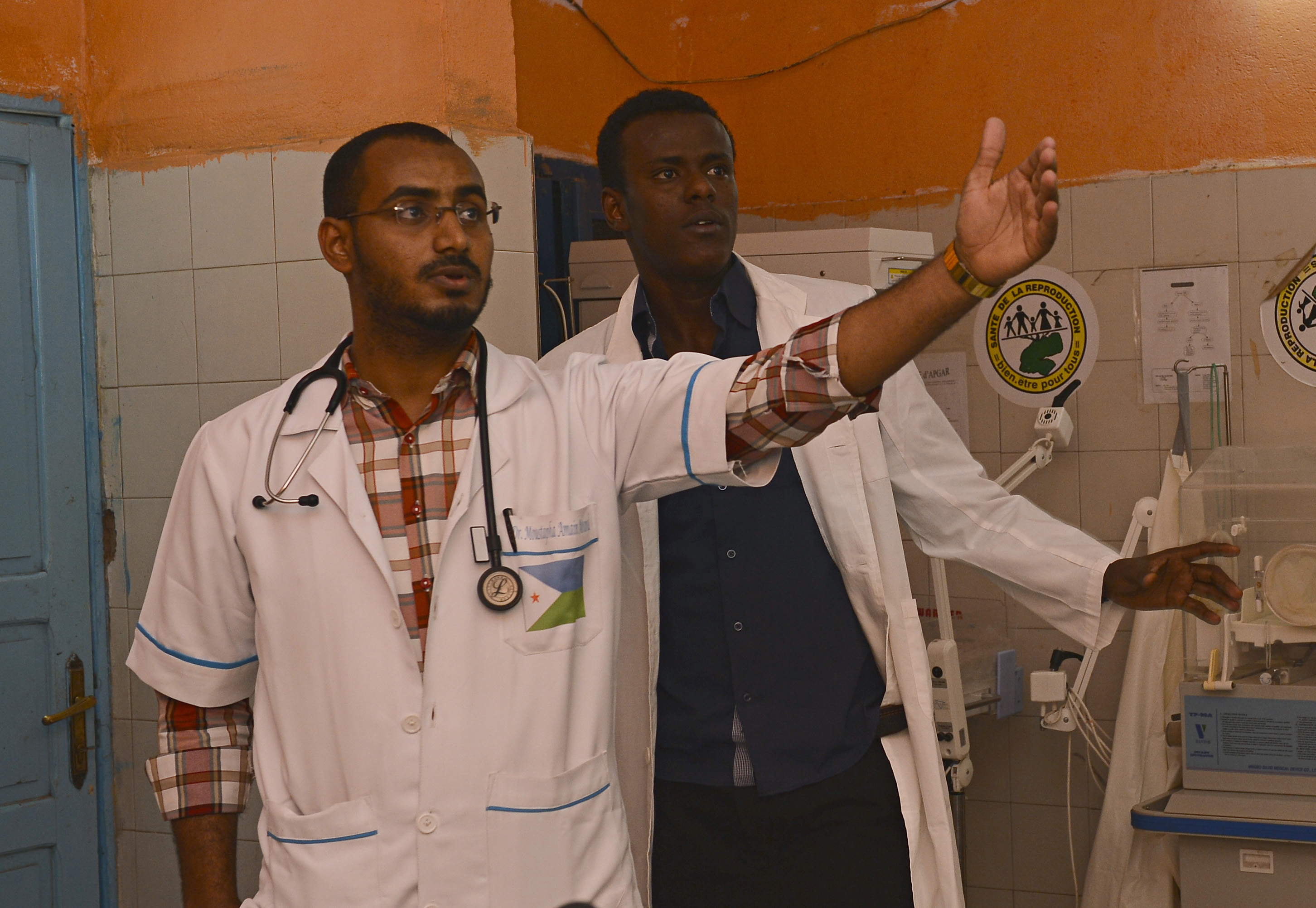 From left, Dr. Moustapha Amain Mouhammad and Dr. Abdi Alias, physicians at the Dikhil Regional Hospital talk about the facility during a tour with Combined Joint Task Force-Horn of Africa members in Dikhil, Djibouti, July 7, 2015. CJTF-HOA members visited the hospital to assess its public health, environmental and preventative medicine capacities and capabilities. (U.S. Air Force photo by Senior Airman Nesha Humes)