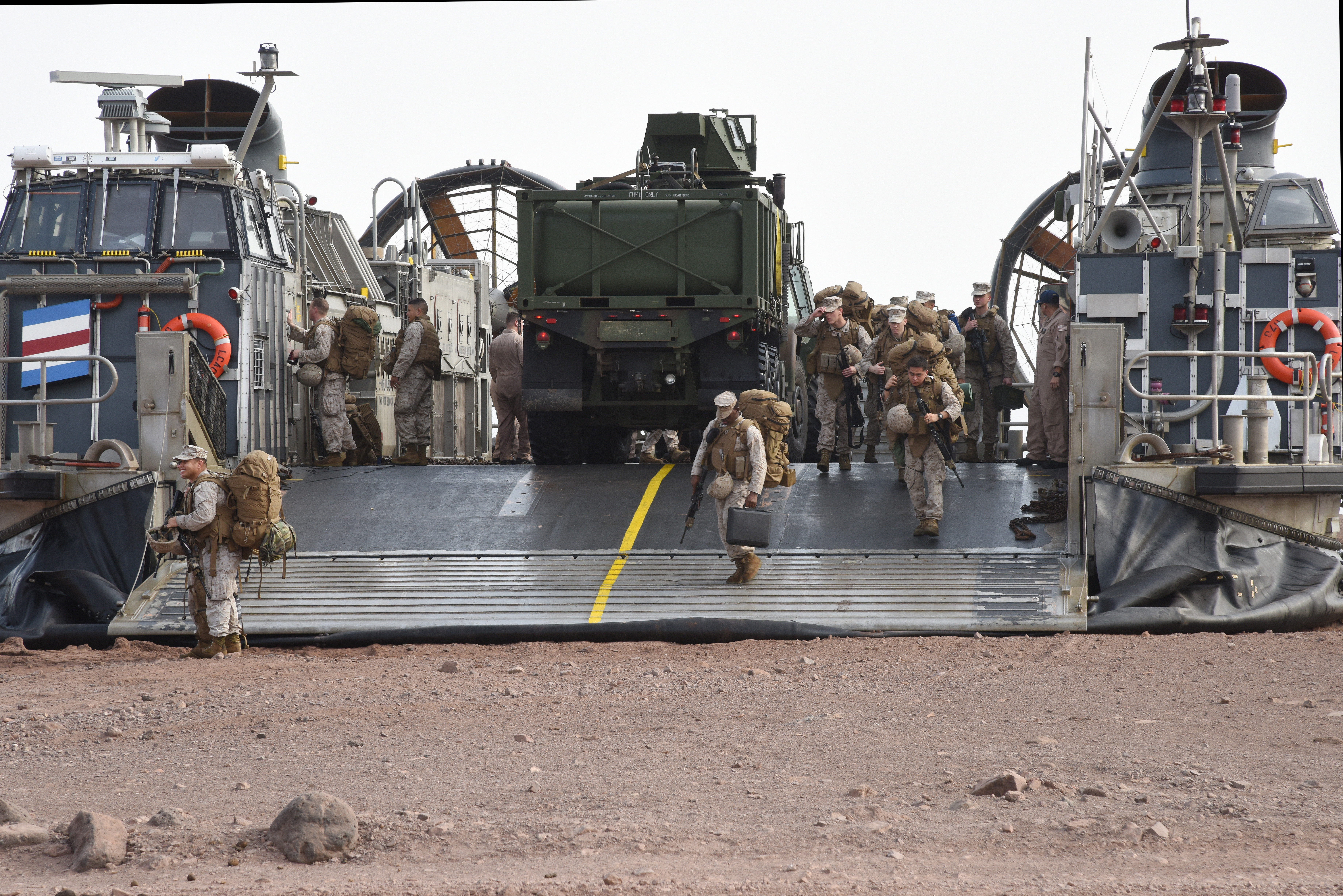 U.S. Marines from the 15th Marine Expeditionary Unit disembark from a U.S. Navy Landing Craft Air Cushion (LCAC) in Arta, Djibouti, July 20, 2015. The Marines came from USS Anchorage for two weeks of training. (U.S. Air Force photo by Staff Sgt. Maria Bowman)