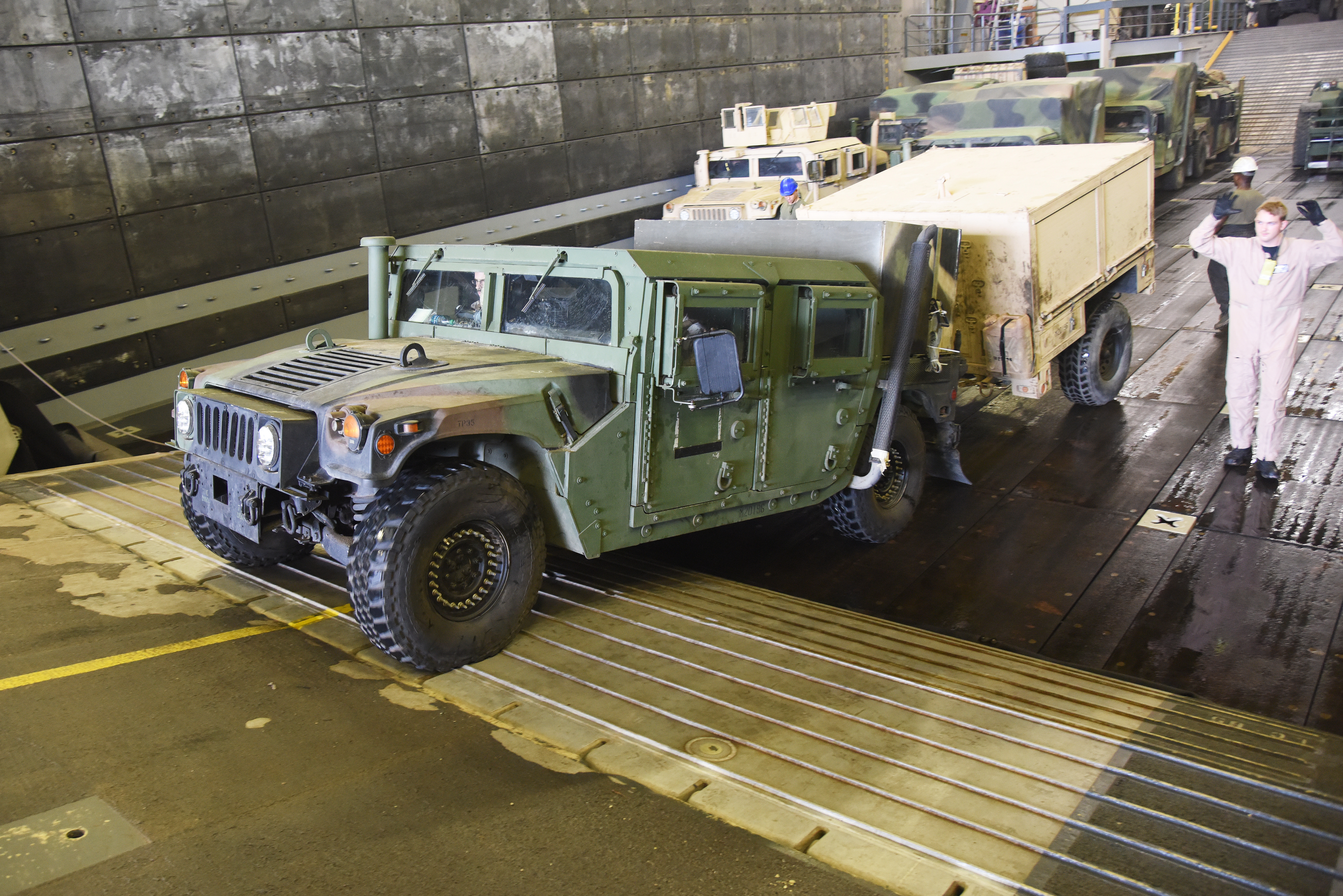 A U.S. Marine HMMWV loads onto a U.S. Navy Landing Craft Air Cushion (LCAC) in Arta, Djibouti, July 20, 2015.  Marine HMMWVs serve as command and control, troop transport, shelter carrier, towed weapons mover, and can be used as an ambulance. (U.S. Air Force photo by Staff Sgt. Maria Bowman)