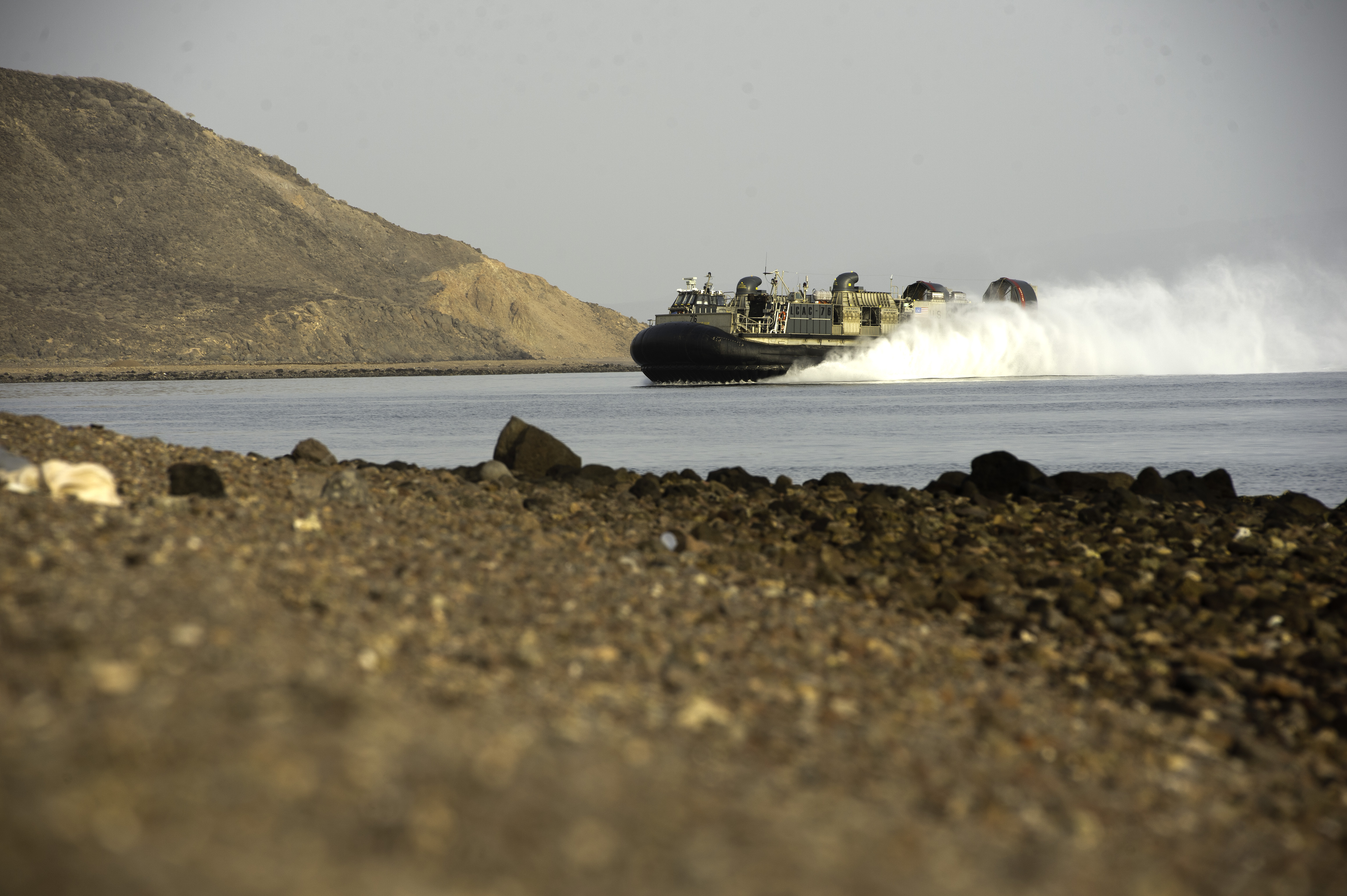 A U.S. Navy Landing Craft Air Cushion (LCAC) approaches a landing zone at Arta Beach, Djibouti, July 20, 2015. The LCAC is a hovercraft used by the U.S. Navy's Assault Craft Units to transport and deliver personnel and equipment from ship to shore and across beaches and was in Djibouti as part of two week sustainment training exercise for the 15th Marine Expeditionary Unit. (U.S. Air Force photo by Staff Sgt. Nathan Maysonet)