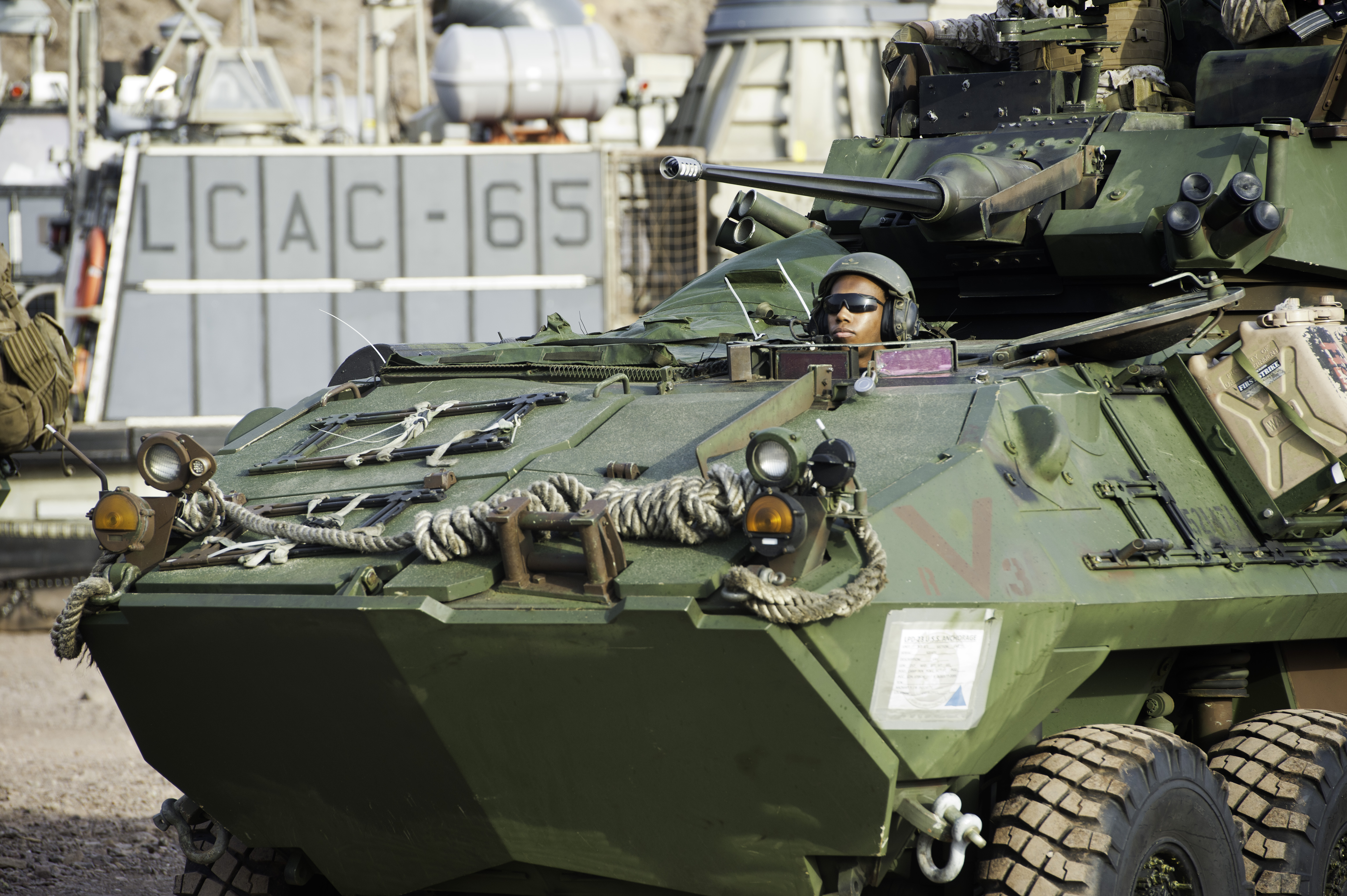 A U.S. Marine Light Armored Vehicle (LAV-25) driver assigned to the 15th Marine Expeditionary Unit, awaits orders after disembarking from a U.S. Navy Landing Craft Air Cushion (LCAC) from the San Antonio-class amphibious transport dock ship USS Anchorage (LPD-23) as part of a two week training exercise at Arta Beach, Djibouti, July 20, 2015. The LAV-25 is a Marine Corps amphibious reconnaissance vehicle used for security, command and control, reconnaissance and assault. (U.S. Air Force photo by Staff Sgt. Nathan Maysonet)