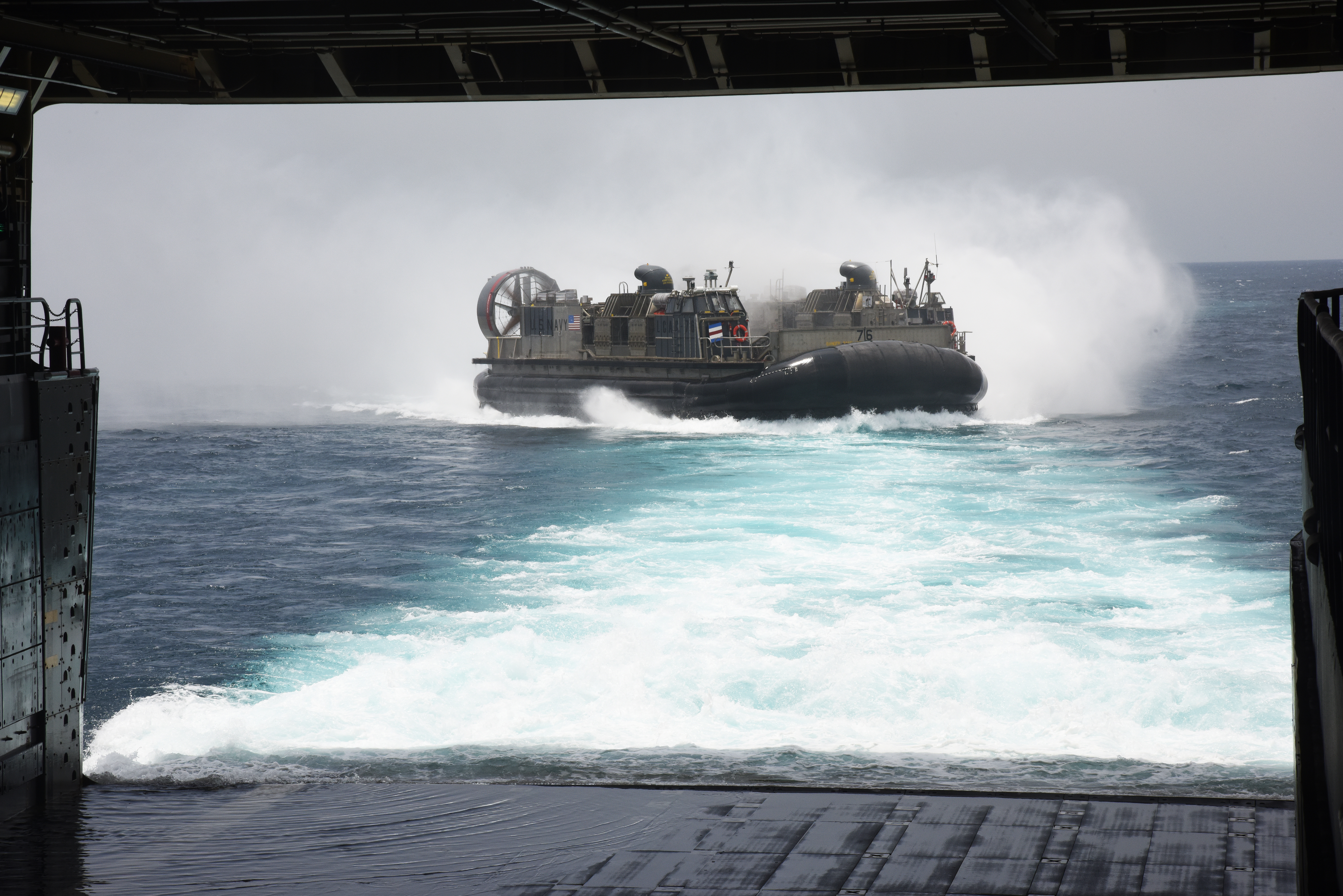 A U.S. Navy Landing Craft Air Cushion (LCAC) approaches the USS Anchorage in Arta, Djibouti, July 20, 2015. The LCAC delivered U.S. Marines and equipment from the U.S. Navy vessel to Arta Beach, to do sustainment training.  (U.S. Air Force photo by Staff Sgt. Maria Bowman)