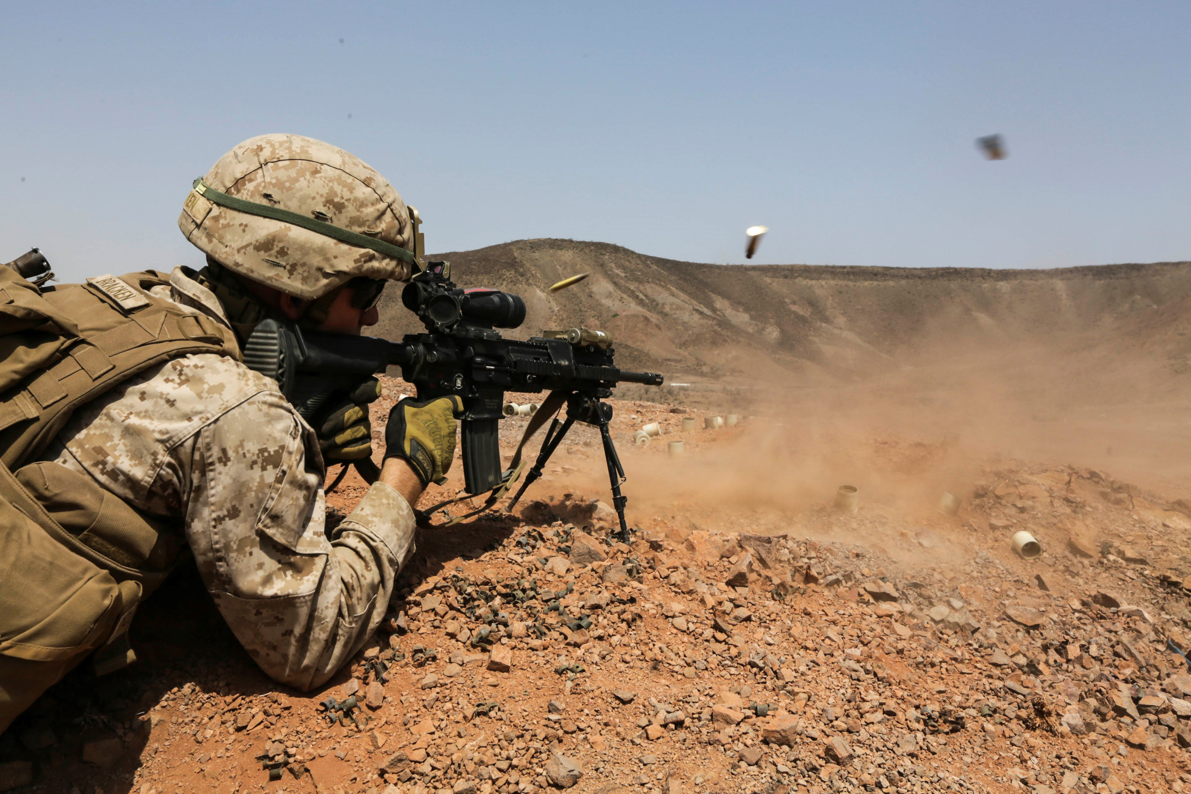 ARTA BEACH, Djibouti (July 22, 2015) A U.S. Marine with Battalion Landing Team 3rd Battalion, 1st Marine Regiment, 15th Marine Expeditionary Unit, fires an infantry automatic rifle during a squad-attack exercise.  The Marines of BLT 3/1 executed a series of attack and maneuver drills consisting of, machine gun, squad and night attacks.  Elements of the 15th Marine Expeditionary Unit are ashore in Djibouti for sustainment training to maintain and enhance the skills they developed during their pre-deployment training period.  The 15th MEU is currently deployed in support of maritime security operations and theater security cooperation efforts in the U.S. 5th and 6th Fleet areas of operation. (U.S. Marine Corps photo by Sgt. Jamean Berry/Released)