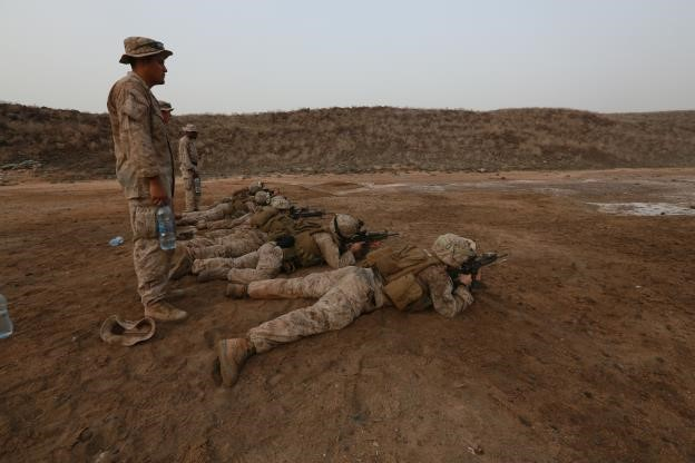 150726-M-ZZ999-020   ARTA BEACH, Djibouti (July 26, 2015)  U.S. Marine Cpl. Joseph Monrreal, left, watches over Marines as they fire their weapons try establish a battle-sight zero. Monrreal was assigned as the personal safety officer during the course of fire and is a vehicle gunner with Combined Anti-Armor Team 1, Weapons Company, Battalion Landing Team 3rd Battalion, 1st Marine Regiment, 15th Marine Expeditionary Unit. Elements of the 15th MEU are ashore in Djibouti for sustainment training to maintain and enhance the skills they developed during their pre-deployment training period. The 15th MEU is currently deployed in support of maritime security operations and theater security cooperation efforts in the U.S. 5th and 6th Fleet areas of operation. (U.S. Marine Corps photo by Gunnery Sgt. Eddy Arce/Released)