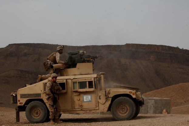 150728-M-ZZ999-035   ARTA BEACH, Djibouti (July 28, 2015) U.S. Marines with Combined Anti-Armor Team 1, Weapons Company, Battalion Landing Team 3rd Battalion, 1st Marine Regiment, 15th Marine Expeditionary Unit, fire an M240B machine gun at their targets during anti-tank sustainment training. Elements of the 15th MEU are ashore in Djibouti for sustainment training to maintain and enhance the skills they developed during their pre-deployment training period. The 15th MEU is currently deployed in support of maritime security operations and theater security cooperation efforts in the U.S. 5th and 6th Fleet areas of operation. (U.S. Marine Corps photo by Gunnery Sgt. Eddy Arce/Released)