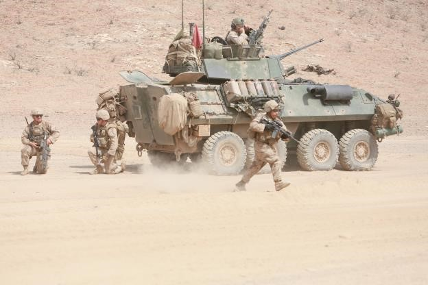 150729-M-TJ275-259   ARTA BEACH, Djibouti (July 29, 2015) U.S. Marines with Light Armored Reconnaissance Detachment, Battalion Landing Team 3rd Battalion, 1st Marine Regiment, 15th Marine Expeditionary Unit, dismount a Light Armored Vehicle (LAV-25) and take their fighting positions during sustainment training. Elements of the 15th MEU are ashore in Djibouti for sustainment training to maintain and enhance the skills they developed during their pre-deployment training period. The 15th MEU is currently deployed in support of maritime security operations and theater security cooperation efforts in the U.S. 5th and 6th Fleet areas of operation. (U.S. Marine Corps photo by Sgt. Steve H. Lopez/Released)
