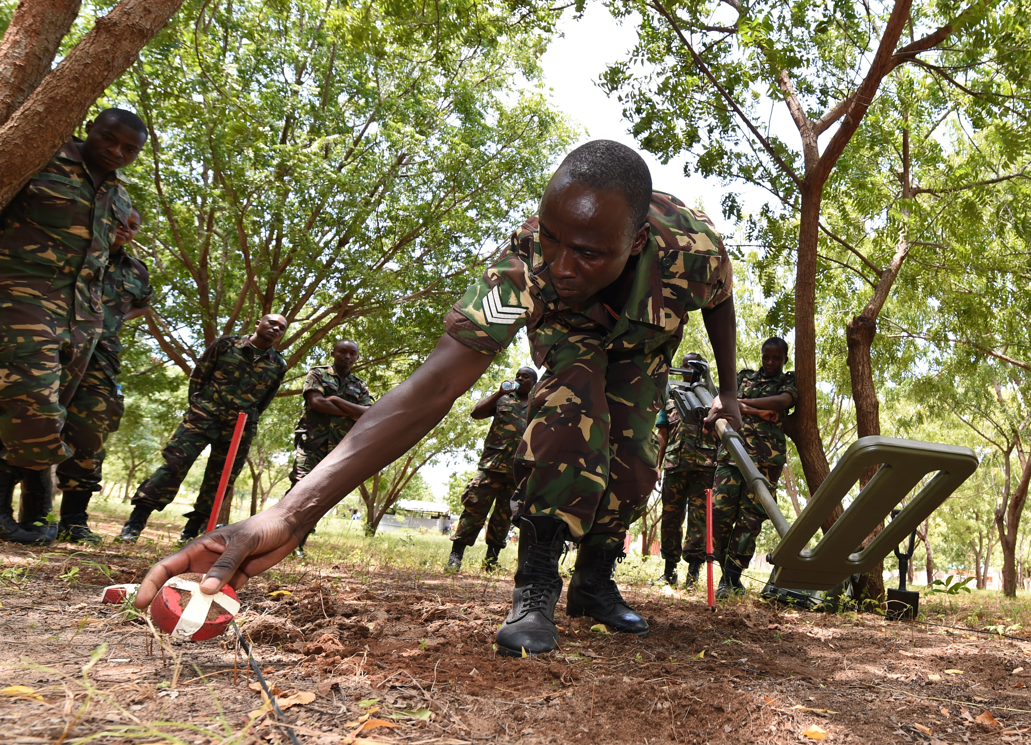 Sgt. Gaudence Siame, Tanzania People's Defense Force ammunition technician, places a metal shape aside during a metal detector familiarization class at the Peace Keeping Training Center in Dar es Salaam, Tanzania Aug. 23, 2015. Two U.S. Navy Explosive Ordnance Disposal technicians, assigned to Combined to Joint Task Force- Horn of Africa, instructed a three-week Humanitarian Mine Action course to TPDF ammunition technicians and officers in order to increase ordnance knowledge. (U.S. Air Force photo by Senior Airman Nesha Humes)