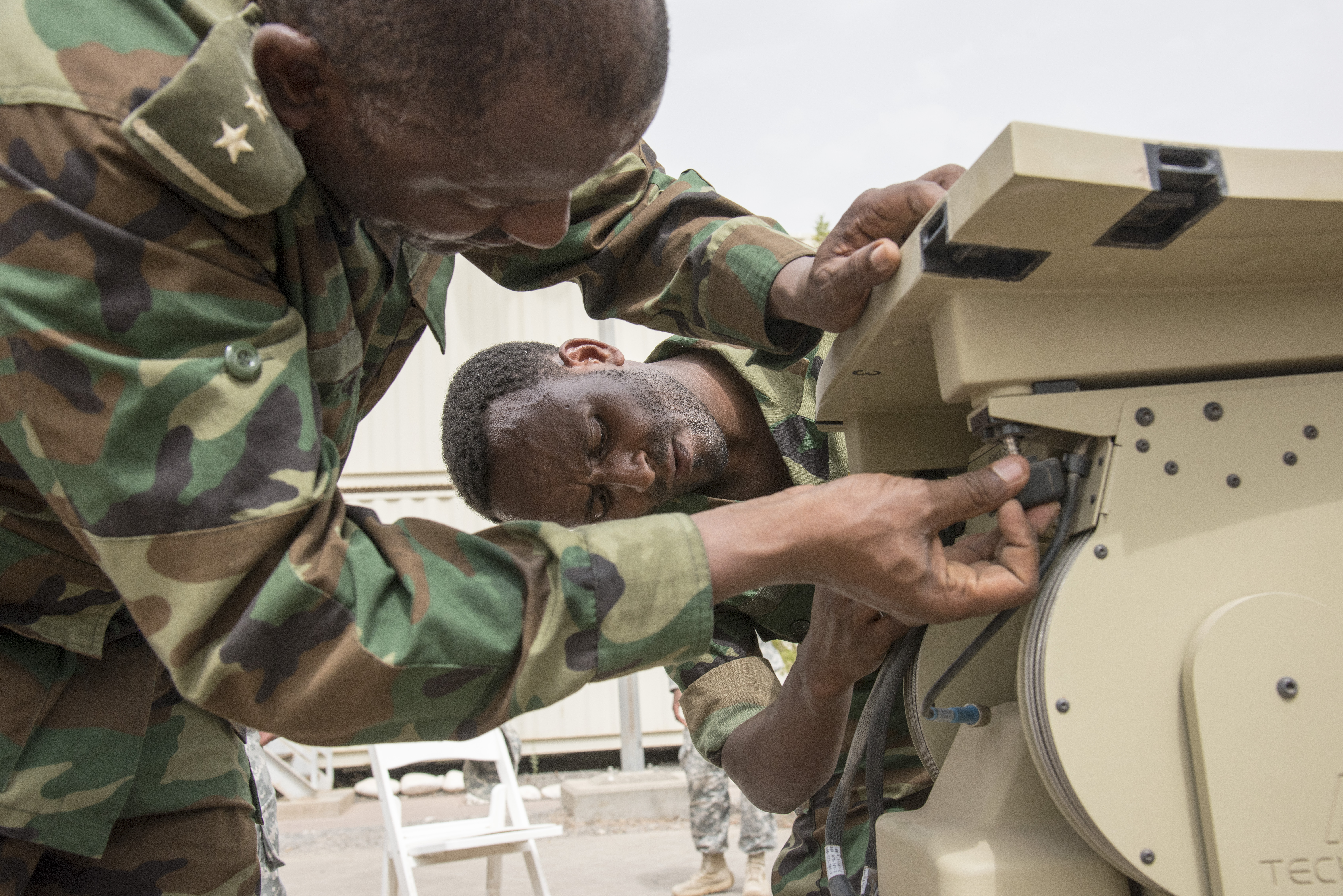 Members of the Ethiopian National Defense Force (ENDF) assemble the dish of a U.S. Africa Command Data Sharing Network (ADSN) terminal at Camp Lemonnier, Djibouti, Aug 18, 2015.  The ADSN terminal is an enclosed network, meaning it never connects to the internet, and is used by African Mission in Somali forces for field communications. Its setup and use was part of a multi-week ADSN course designed to broaden communication interoperability between host nation security forces, and was hosted by communications and intelligence personnel assigned to Combined Joint Task Force-Horn of Africa. (U.S. Air Force photo by Staff Sgt. Nathan Maysonet/released)