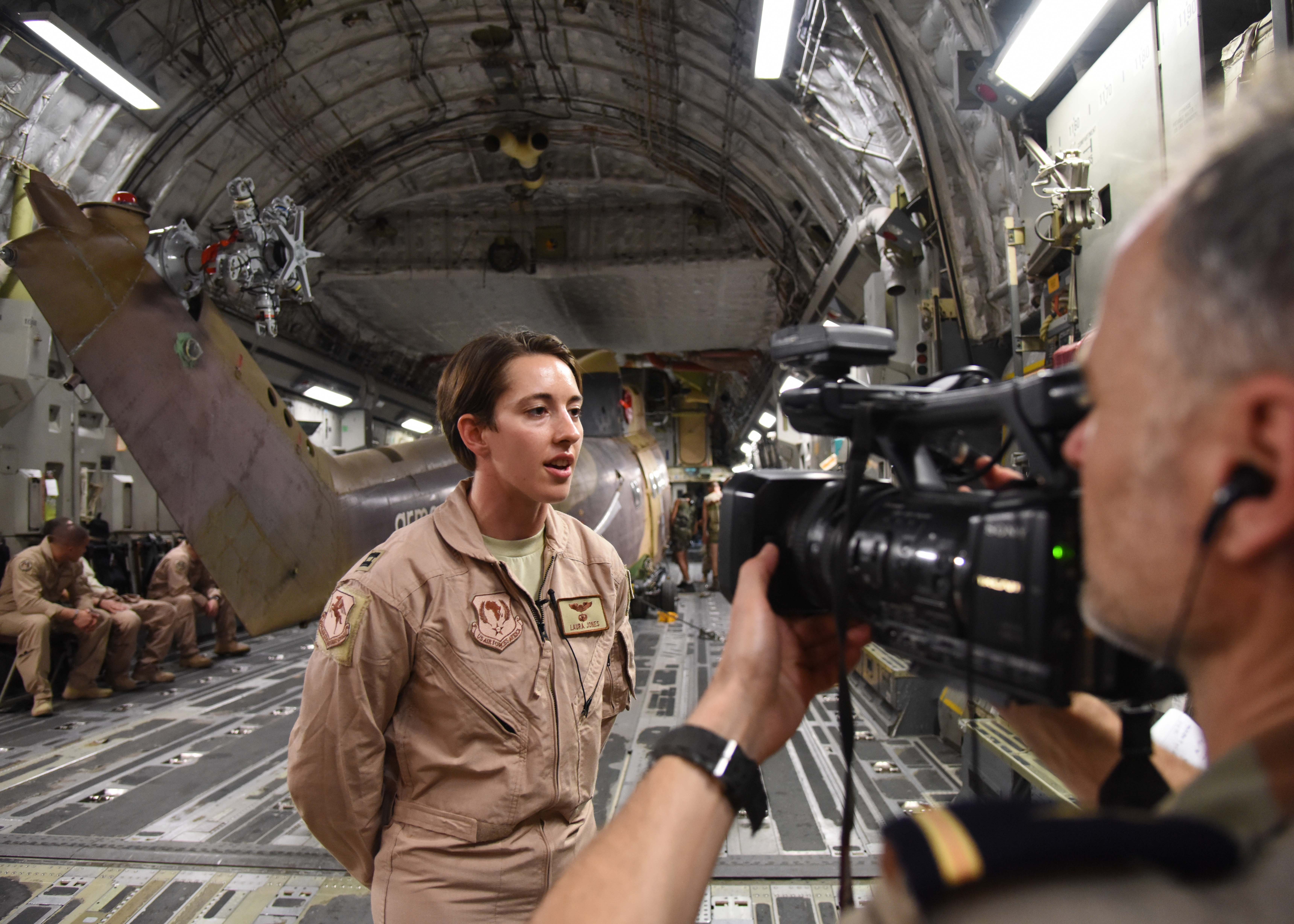 150822-N-DJ346-023 CAMP LEMONNIER, Djibouti (August 22, 2015) Air Force Capt. Laura Jones, Liaison Officer to French Forces in Djibouti, is interviewed by French Forces Public Affairs. French and U.S. service members transport two French Puma Helicopters and associated Passengers & Cargo to N'Djamena aboard a U.S. Air Force C-17 Globemaster. The helicopters support French operations at the intersecting borders of Libya, Chad and Niger deterring weapons and drug smuggling, and jihadist regularly crossing between nations. This is the first time France has received support from U.S. Forces in Djibouti for any mission outside of East Africa. (U.S. Navy photo by Chief Mass Communication Specialist Donald W. Randall/Released)