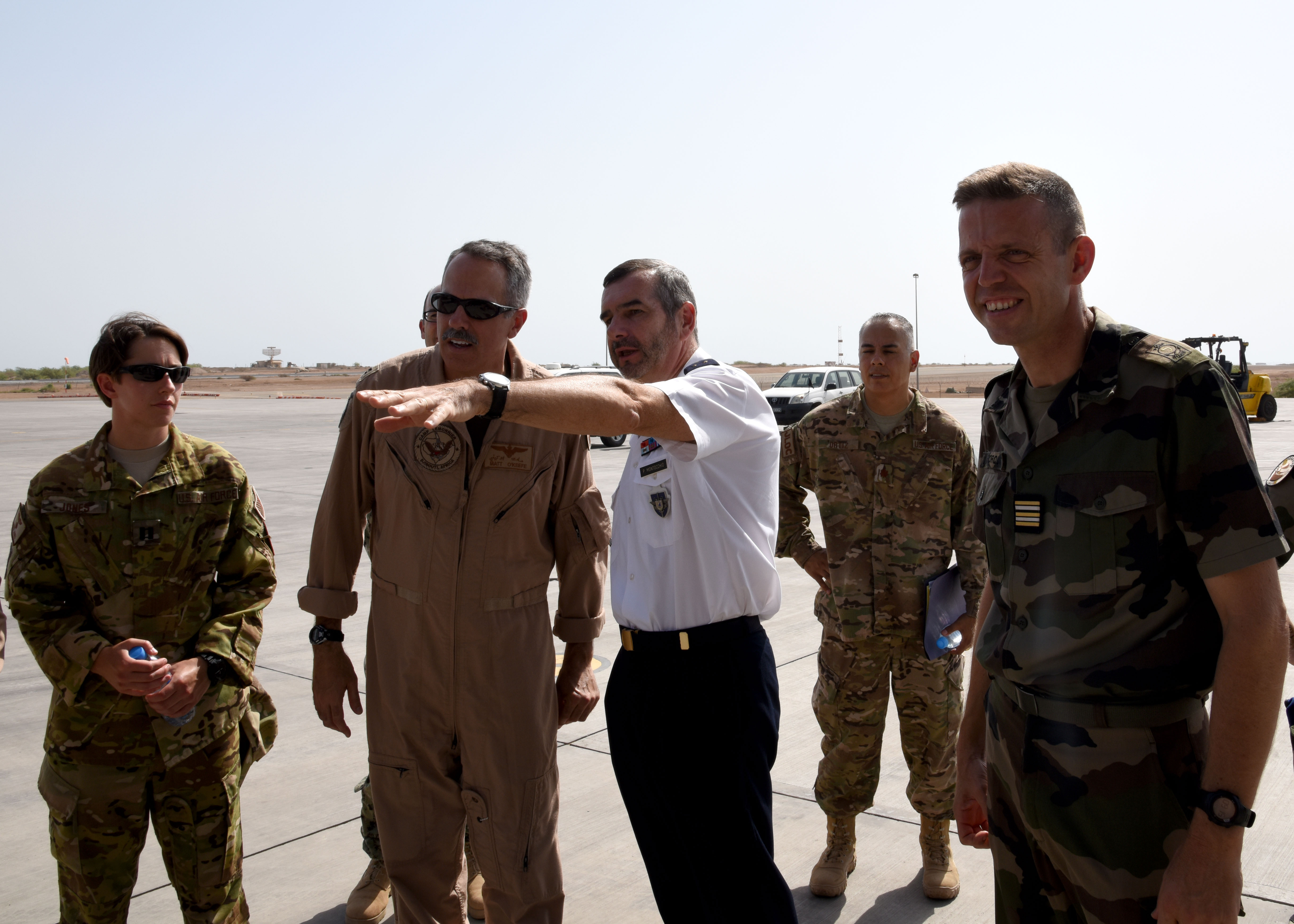 150823-N-DJ346-014 CAMP LEMONNIER, Djibouti (August 23, 2015) General Mon Tocchio, Commanding Officer, French Forces Djibouti and U.S. Navy Captain Matthew O'Keefe, Commanding Officer, Camp Lemonnier, Djibouti, discuss loading operations. French and U.S. service members prepare to transport two French Puma Helicopters and associated Passengers & Cargo to N'Djamena aboard a U.S. Air Force C-17 Globemaster. The helicopters support French operations at the intersecting borders of Libya, Chad and Niger deterring weapons and drug smuggling, and jihadist regularly crossing between nations. This is the first time France has received support from U.S. Forces in Djibouti for any mission outside of East Africa. (U.S. Navy photo by Chief Mass Communication Specialist Donald W. Randall/Released)
