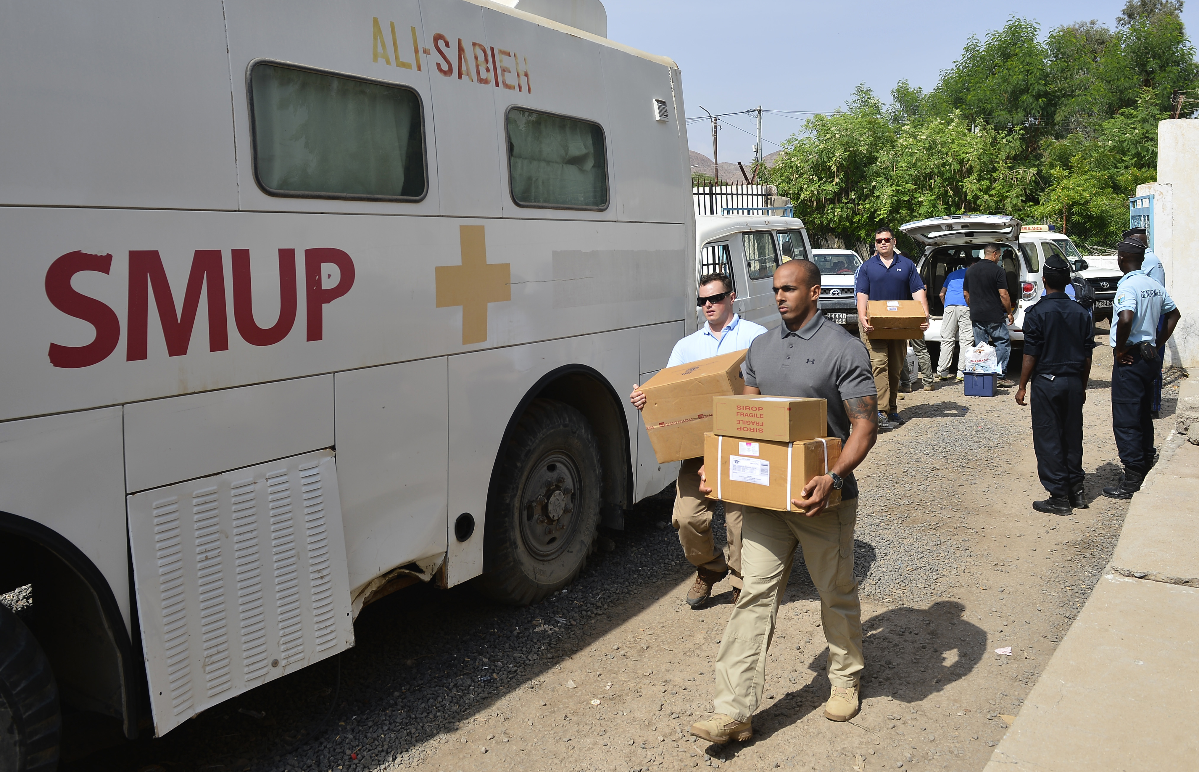 Members of the U.S. Army's 404th Civil Affairs Battalion, assigned to Combined Joint Task Force-Horn of Africa, unload medical supplies at Ali Sabieh Medical Clinic in Djibouti, Africa, Sept. 12, 2015. The 404th CA BN partnered with Djibouti's Ministry of Health to host a Medical Civic Action Program outreach event. They provided an obstetrician-gynecologist, pediatrician, dentist and ophthalmologist for the rural people. (U.S. Air Force photo by Senior Airman Nesha Humes)