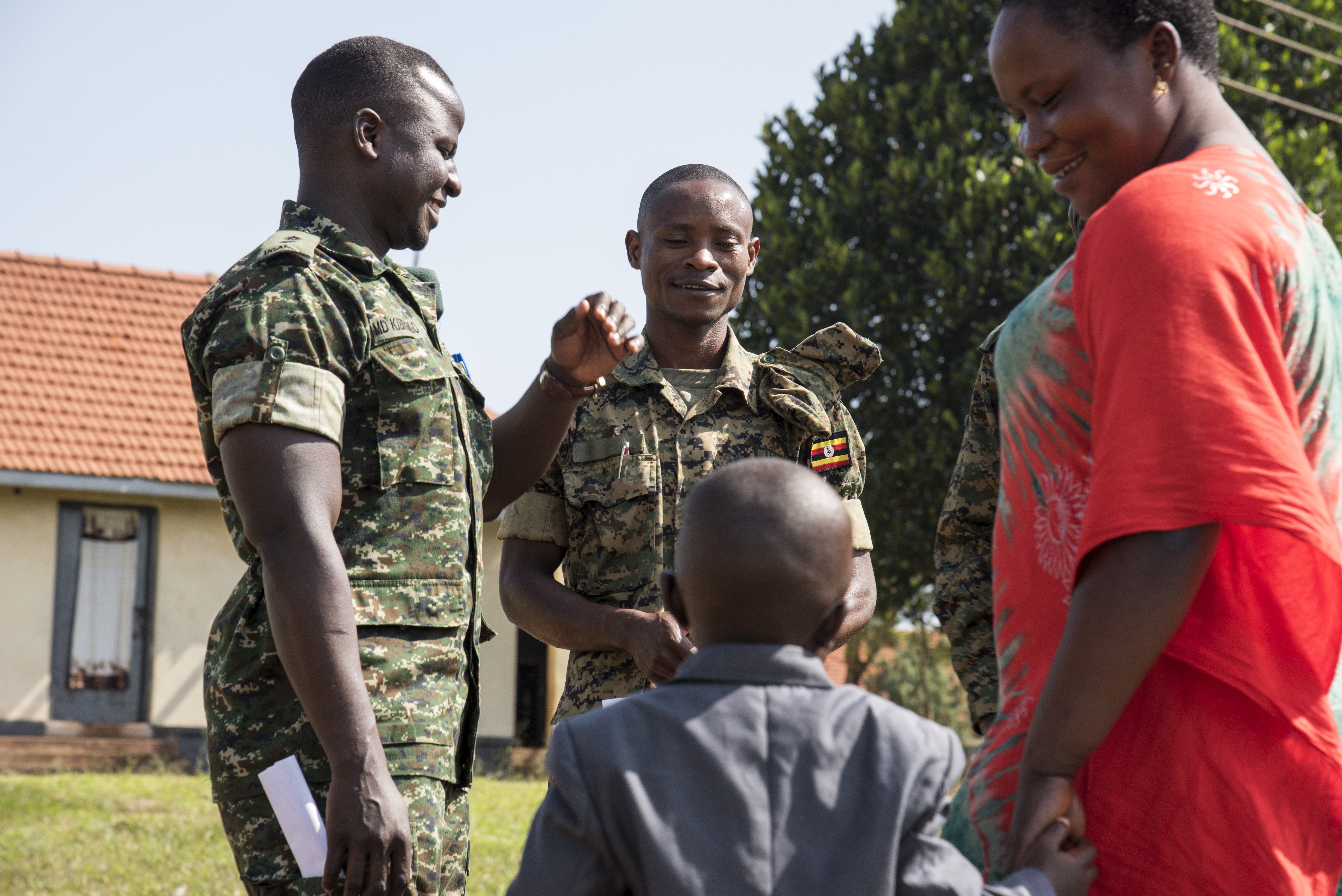 Members of the Uganda People's Defense Force (UPDF) speak to a mother and her child during an information operations field exercise hosted by personnel from Combined Joint Task Force-Horn of Africa, in Jinja, Uganda, recently. During the multi-week course on message planning and dissemination, attendees learned how to engage persons in face-to-face communications in order to disseminate messages on health and wellness, emergency services, and to counter violent extremist organization propaganda.  (U.S. Air Force photo by Staff Sgt. Nathan Maysonet)