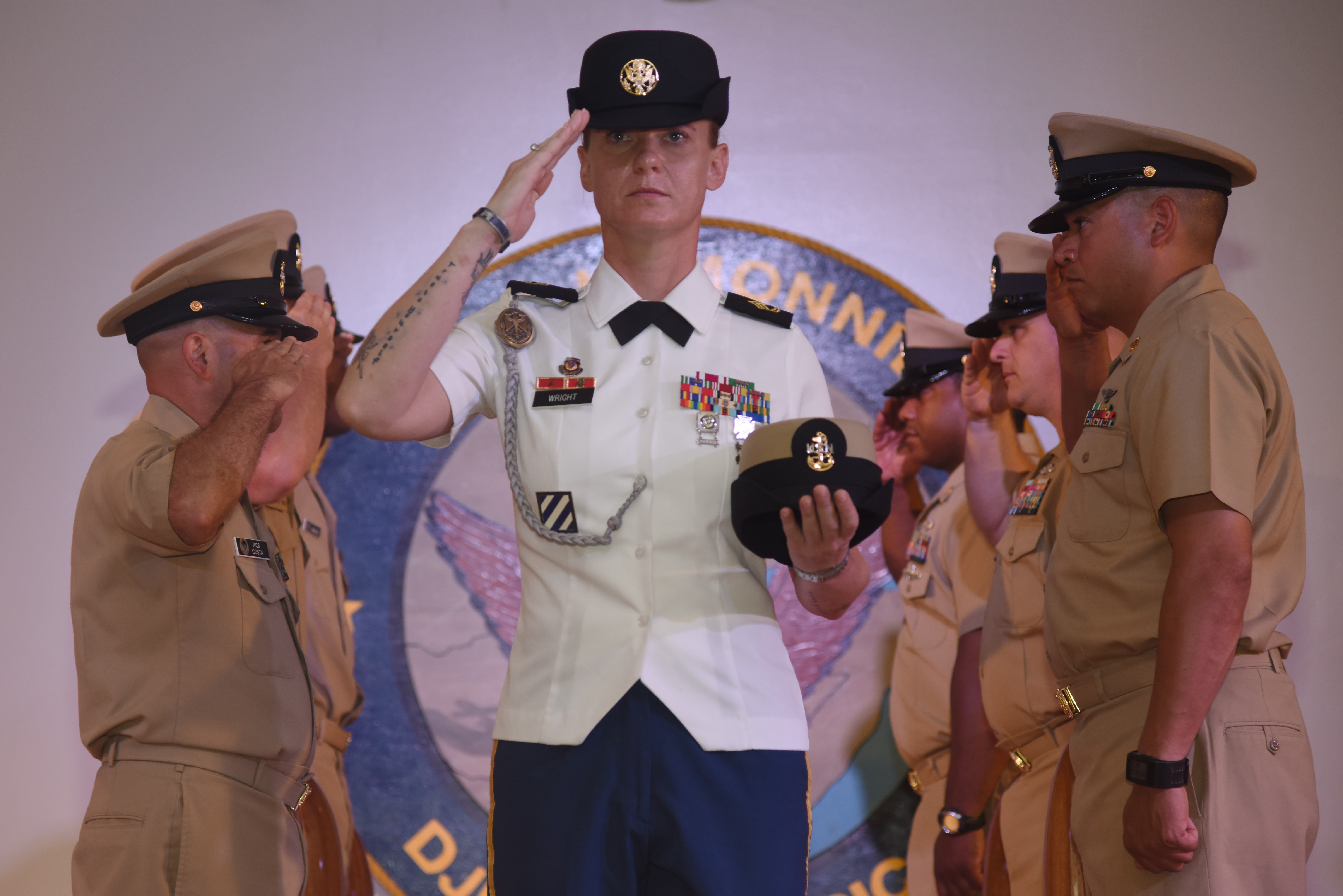 U.S. Army Sgt. 1st Class Heather Wright, gives a salute during a pinning ceremony at Camp Lemonnier, Djibouti, Sept. 16, 2015.  Wright was the only Army soldier to attend the Navy Chief Petty Officer 365 Phase Two season at the camp, which teaches leadership and resiliency skills to senior noncommissioned officers.  (U.S. Air Force photo by Staff Sgt. Maria Bowman)