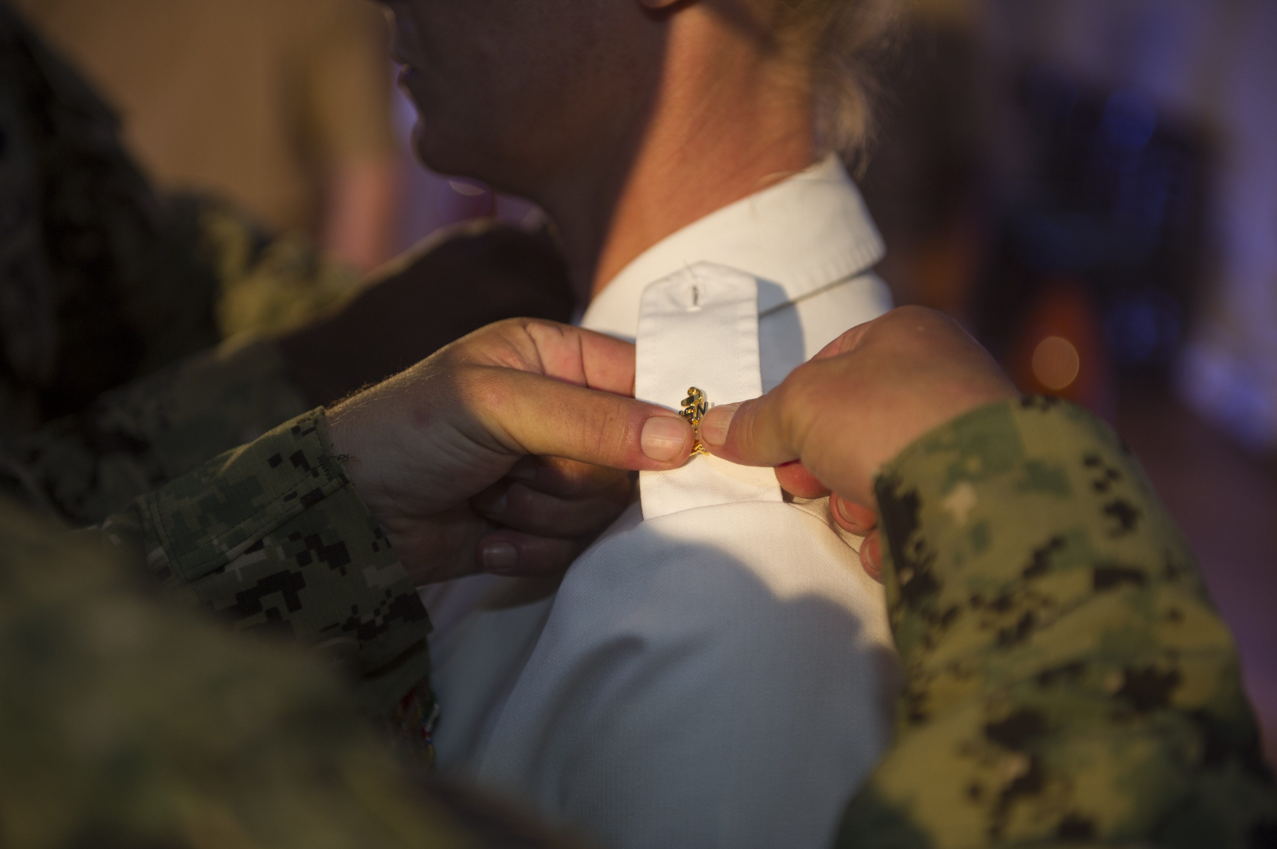 U.S. Army Sgt. 1st Class Heather Wright, receives an anchor, symbolizing her status as an honorary member of Camp Lemonnier's Chief Petty Officers Mess, during a pinning ceremony at Camp Lemonnier, Djibouti, Sept. 16, 2015.  The two-month Navy Chief Petty Officer 365 Phase Two season develops new chief petty officers through challenging mental and physical activities. (U.S. Navy Petty Officer 1st Class Drae Parker)