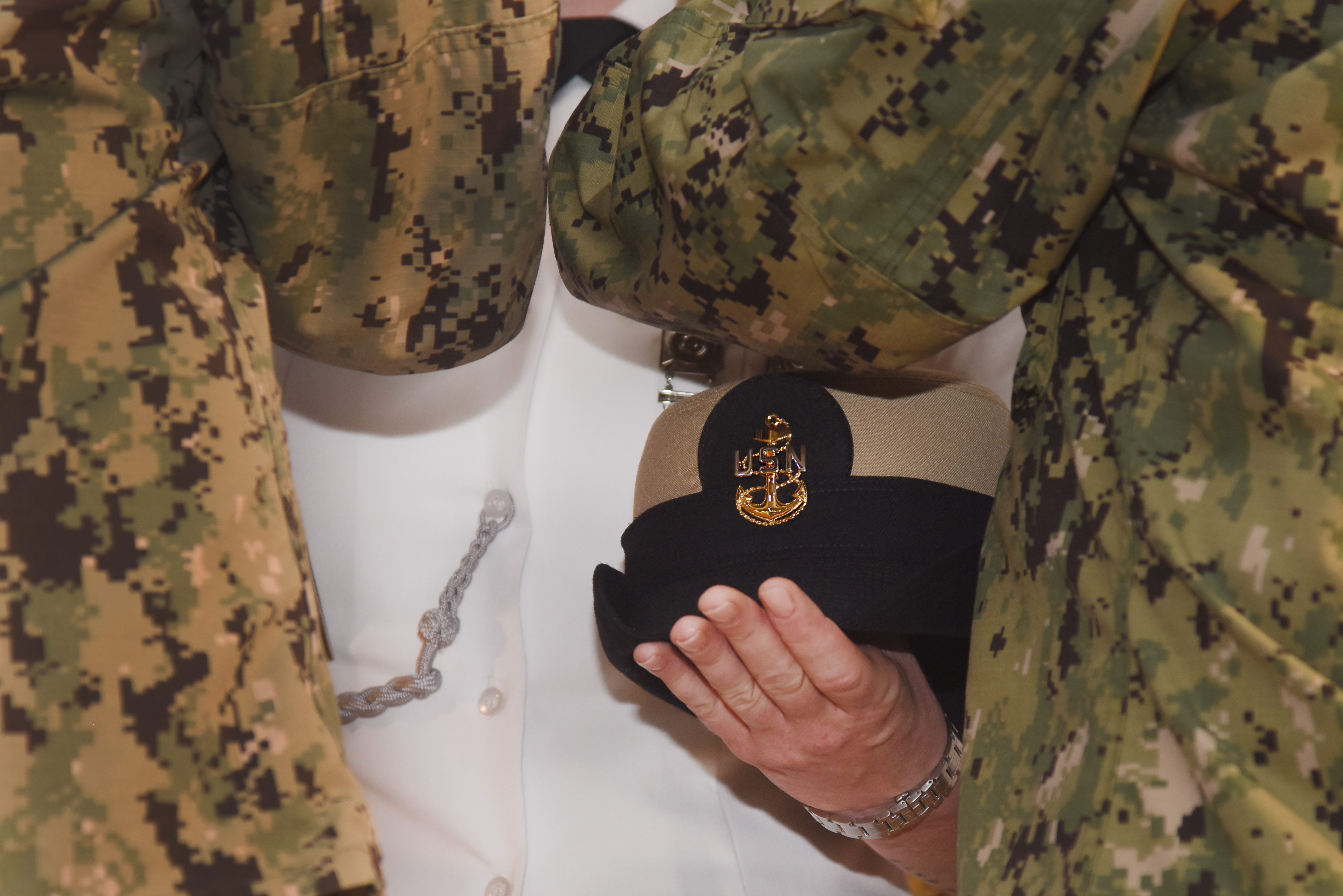 U.S. Army Sgt. 1st Class Heather Wright, receives an anchor, symbolizing her status as an honorary member of Camp Lemonnier's Chief Petty Officers Mess, during a pinning ceremony at Camp Lemonnier, Djibouti, Sept. 16, 2015.  The two-month Navy Chief Petty Officer 365 Phase Two season develops new chief petty officers through challenging mental and physical activities. (U.S. Air Force photo by Staff Sgt. Maria Bowman)