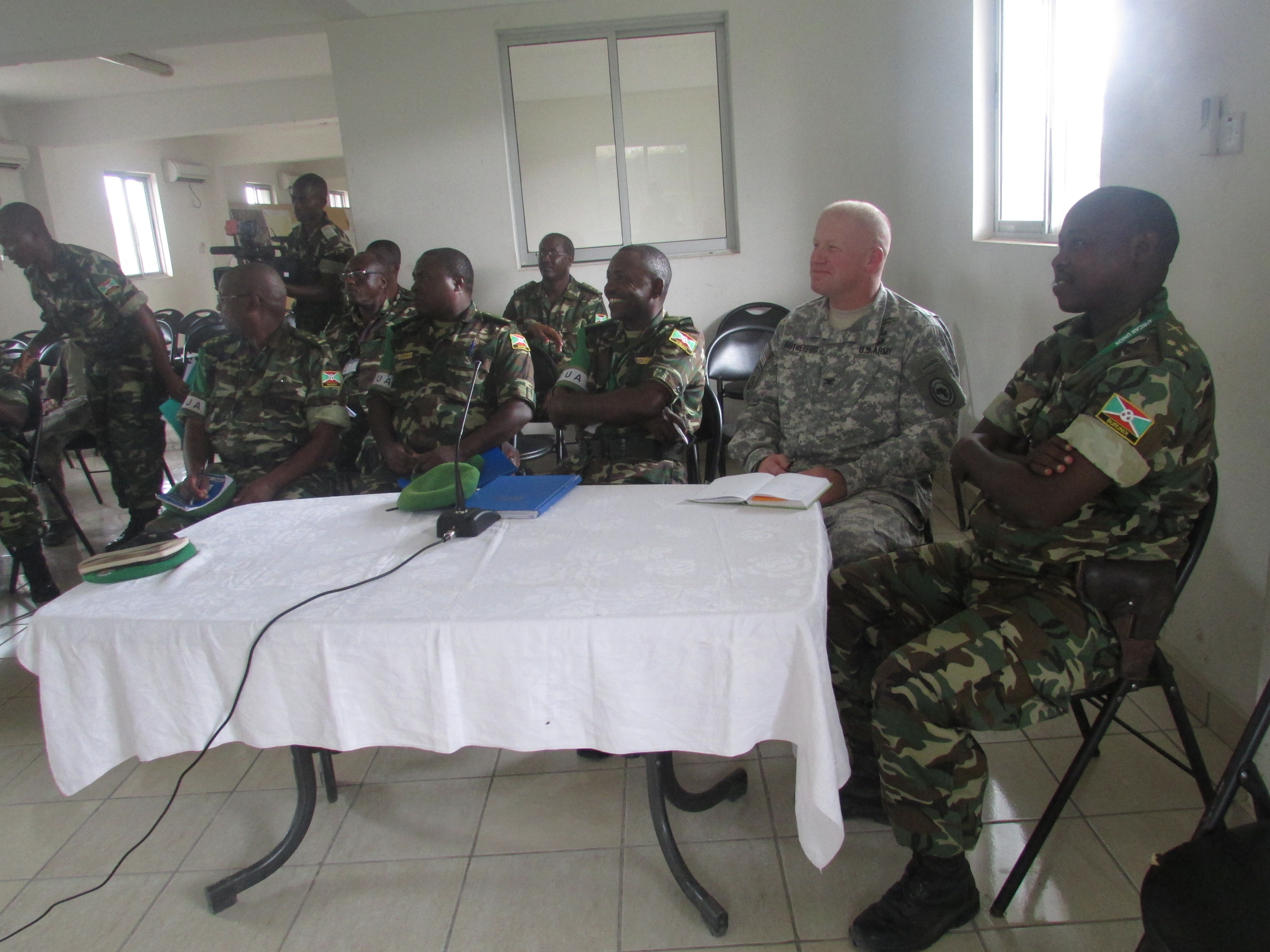 U.S. Army Col. Wilson Rutherford, U.S. Military Coordination Cell Mogadishu and Col. Bibonimana, Burundi National Defense Forces right, receive an Operations and Intelligence update from the BNDF staff offensive during a visit to the African Union Mission in Somalia Sector 5 Headquarters located in northern Mogadishu.  The MCC's mission is to increase defense capability, capacity, and coordination among its East African partner in their pursuit to neutralize violent extremist organizations.  (BNDF Courtesy Photo)