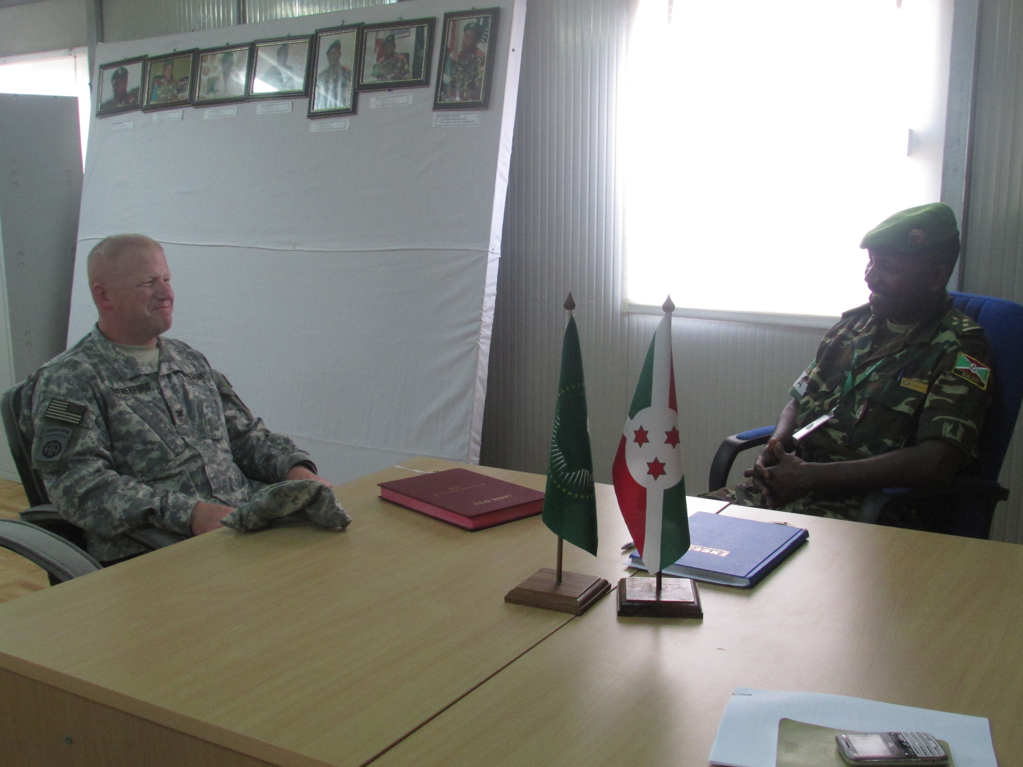 Col. Bibonimana, right, Burundi National Defense Forces, jokes with U.S. Army Col. Wilson Rutherford, U.S. Military Coordination Cell Mogadishu, during a visit to the African Union Mission in Somalia Sector 5 Headquarters located in northern Mogadishu. The MCC provides planning and advisory support to the AMISOM and Somali security forces to increase their capabilities and promote peace and security throughout Somalia and the region. (BNDF Courtesy Photo)