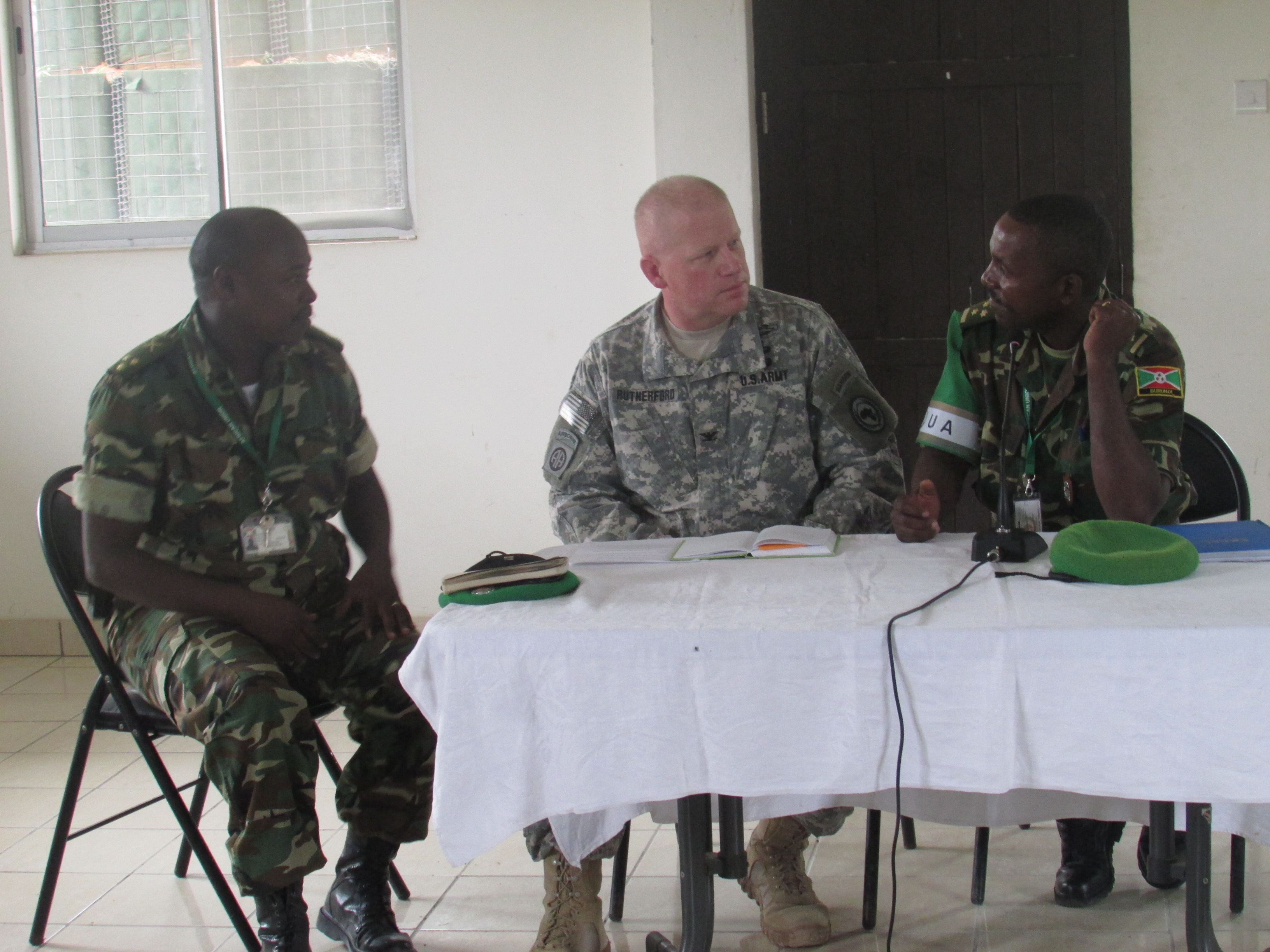 U.S. Army Col. Wilson Rutherford, center, U.S. Military Coordination Cell Mogadisu, addresses Burundi National Defense Forces staff on the U.S. commitment to support BNDF serving in the African Union Mission in Somalia during a visit to the AMISOM Sector 5 Headquarters located in northern Mogadishu. The MCC is a prime component of the Combined Joint Task Force –Horn of Africa whose mission is to help build the defense capability, capacity, and coordination among its East African partners to improve capacity to neutralize violent extremist organizations.  (BNDF Courtesy Photo)